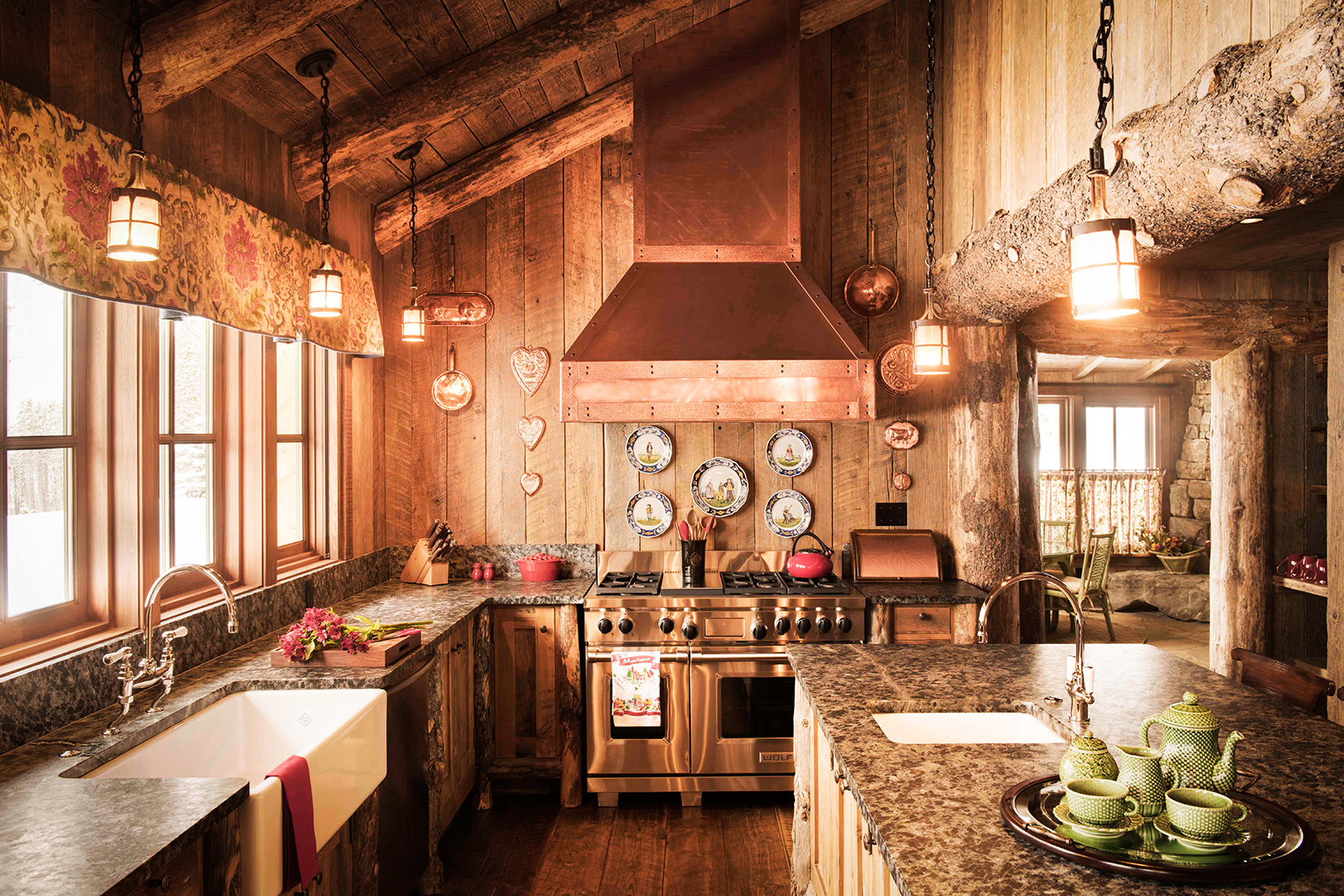 This kitchen is all rustic, from the farmhouse style detail, to the exposed beams, to the wood planked walls... love! Located in  Yellowstone Club