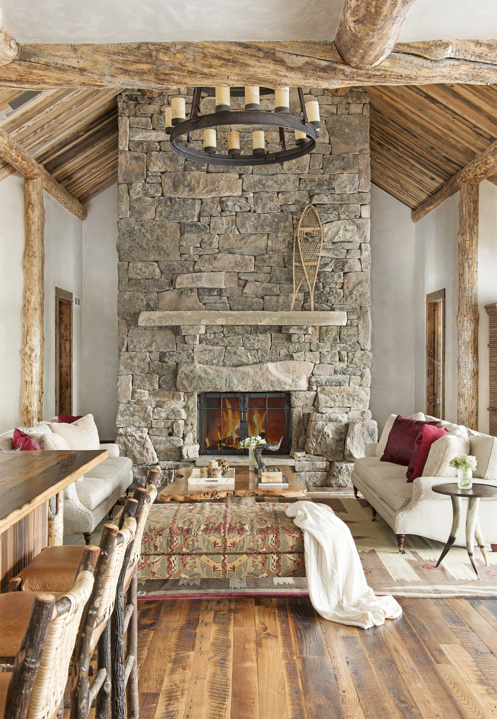 The textures are so impressive in this room - from the custom stone fireplace to the wood floor and wood beams throughout. Very impressive. Located in  Yellowstone Club.