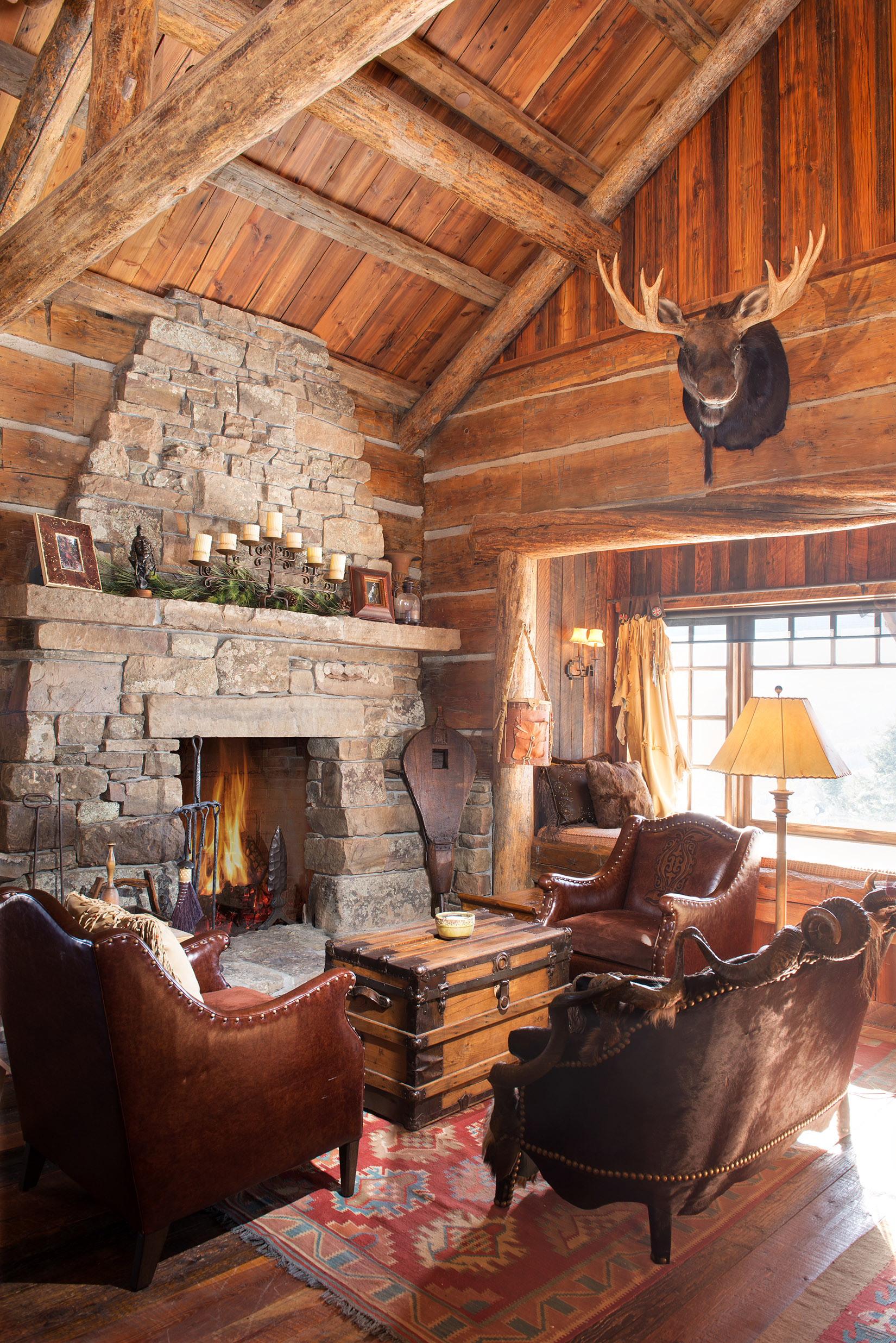 The rustic architecture is so cozy in this home. I could definitely sit next to this fireplace and enjoy a nice warm beverage for a long time! Located at  Yellowstone Club .