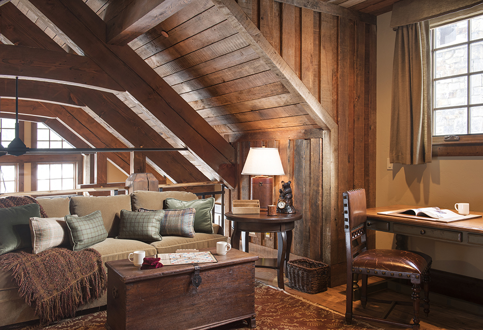 This cozy nook has all the rustic elements with the wood paneling and exposed beams. Architect -  Locati Architects