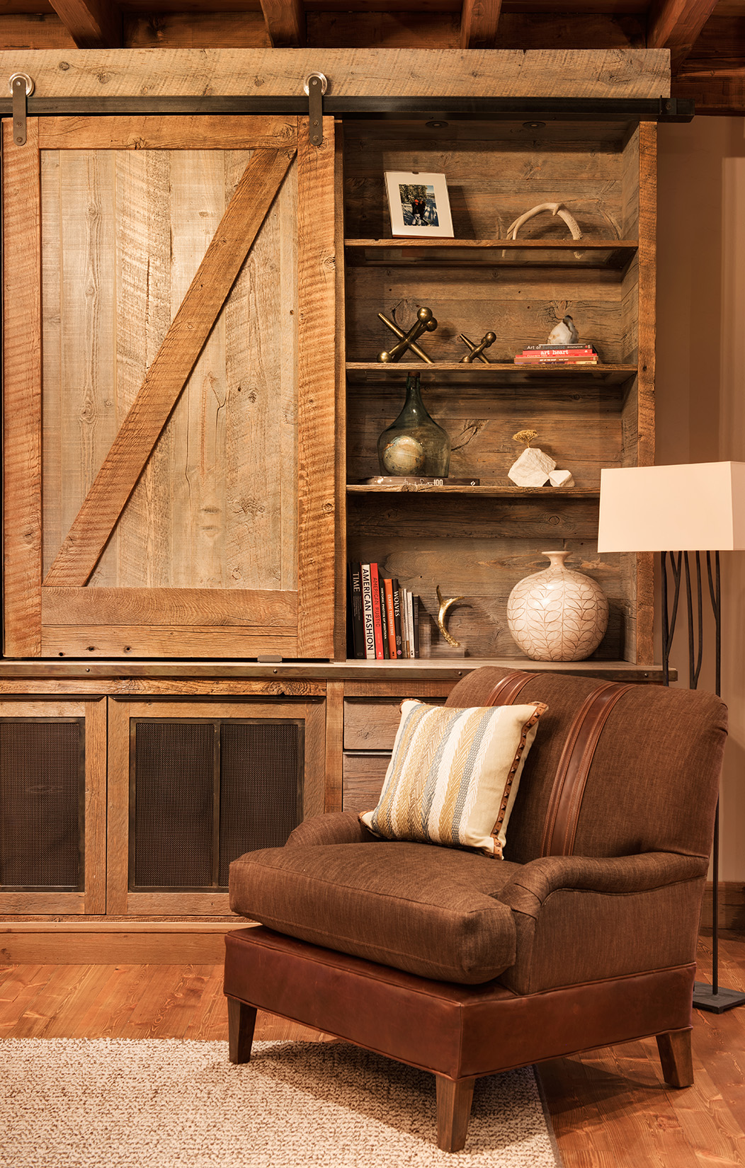 The sliding barn door and reclaimed wood shelves are fantastic! Interior Design -  Varda Interiors