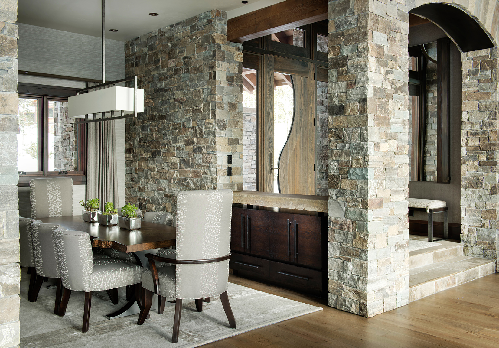 This custom stone work is what draws me to this amazing dining room.  So wonderful!   Varda Interiors ,  Yellowstone Club