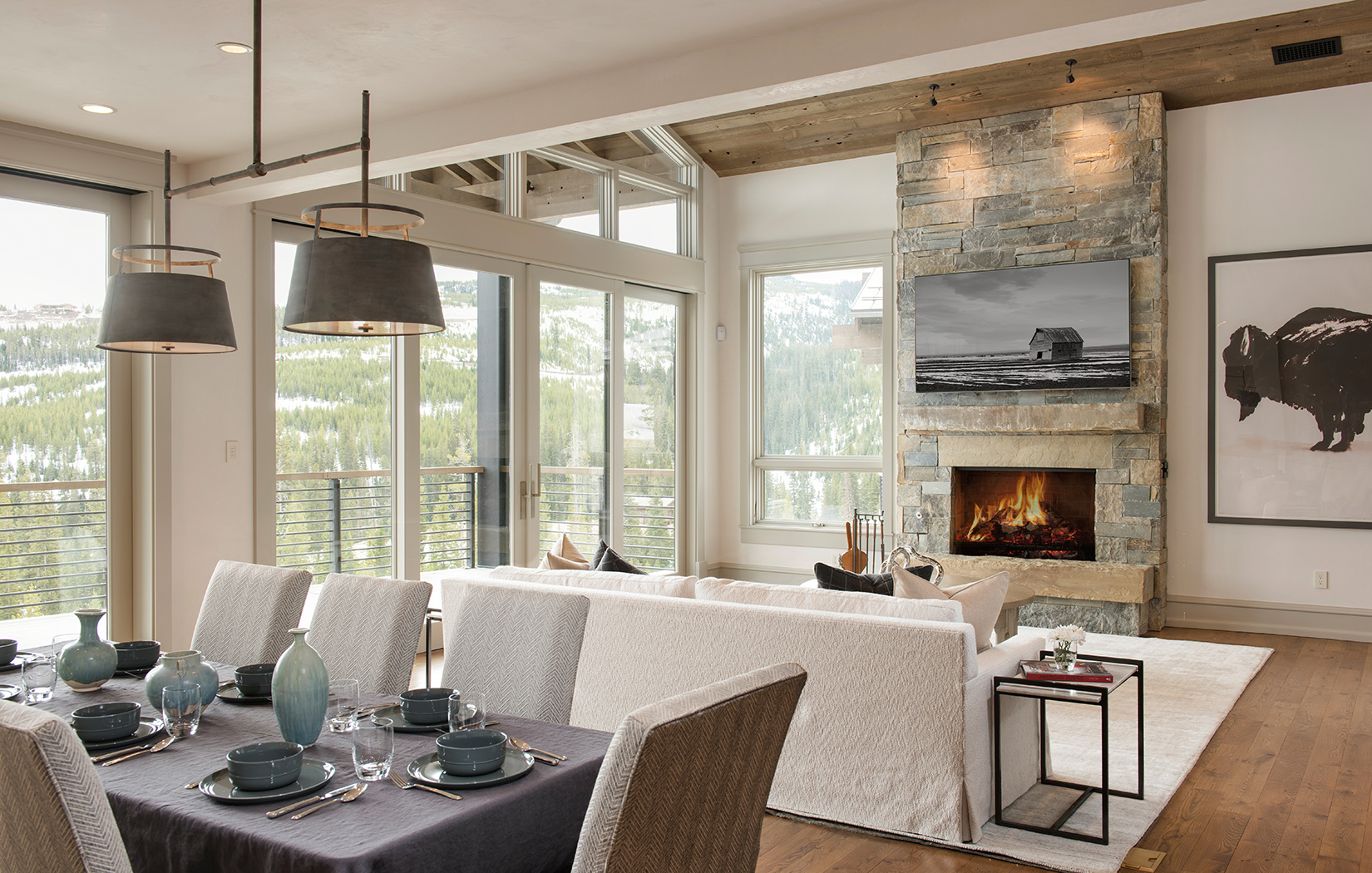 There is so much I love about this dining space - the open layout, the big windows, and that stacked stone fireplace to name a few:) .  Locati Architects ,  Yellowstone Club