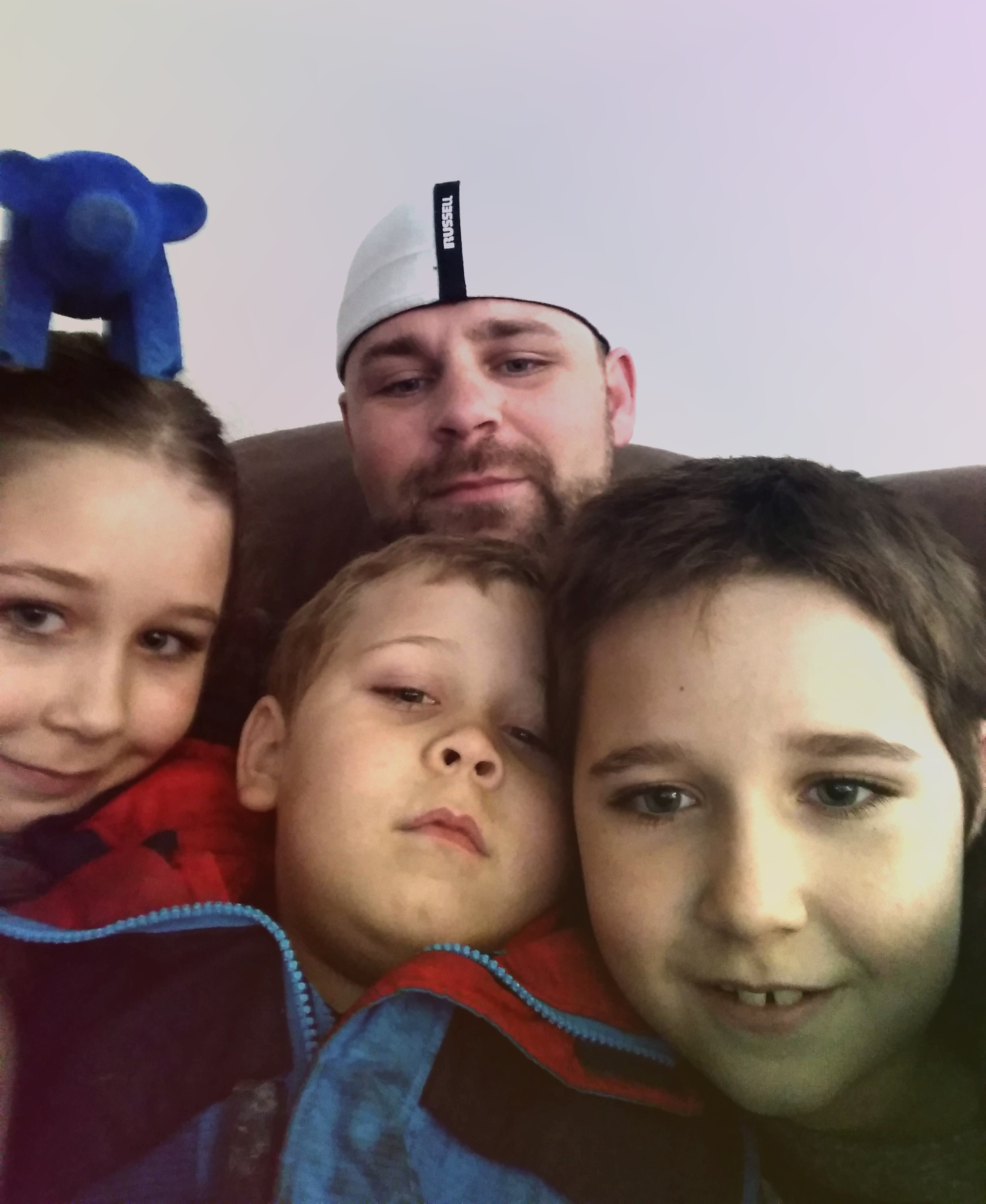 Top - Father Ricky Dominguez       Left to right - Lilly, Tuck & Kadin