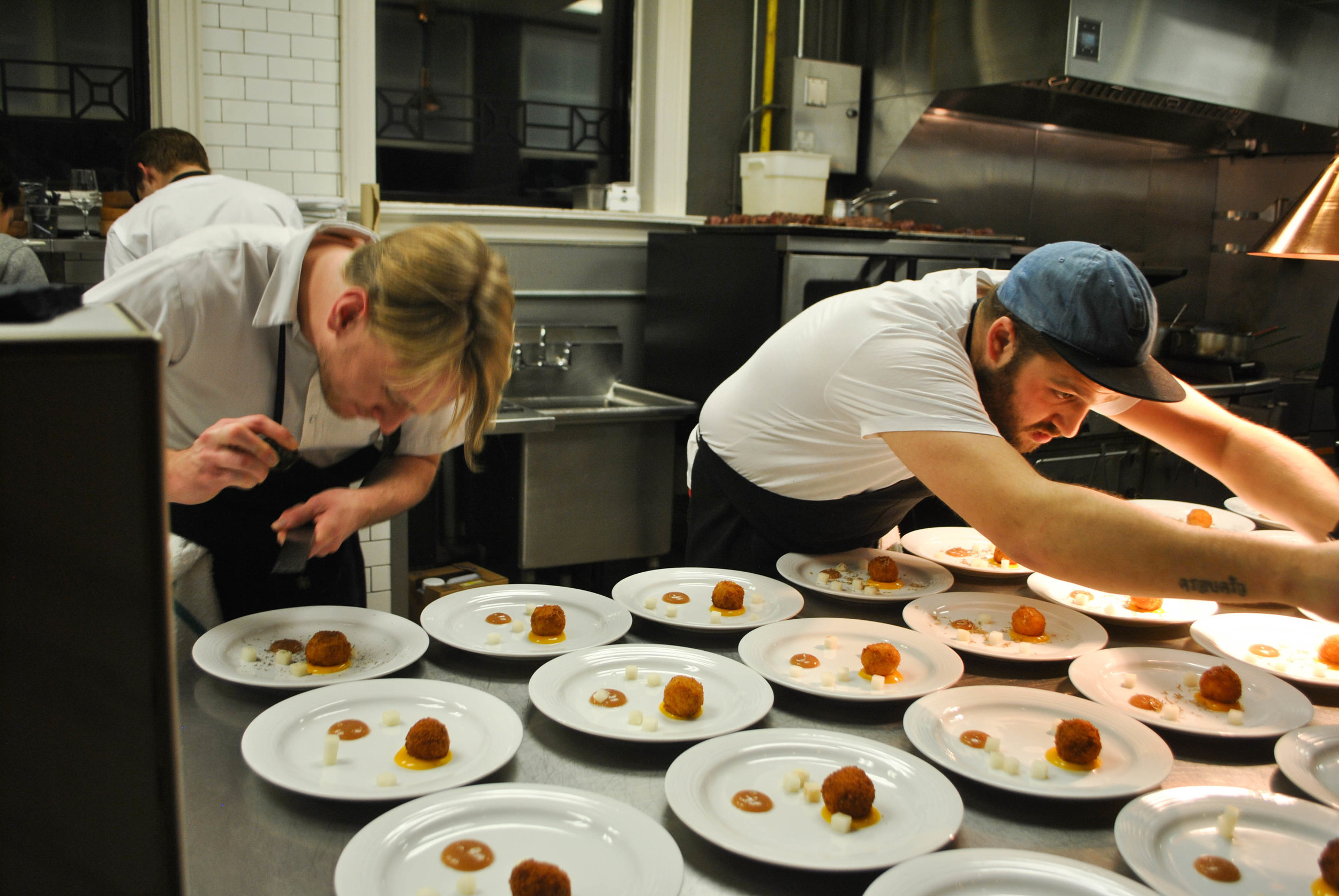 Jesse Zuber and Benet Hunt plating the 3rd course