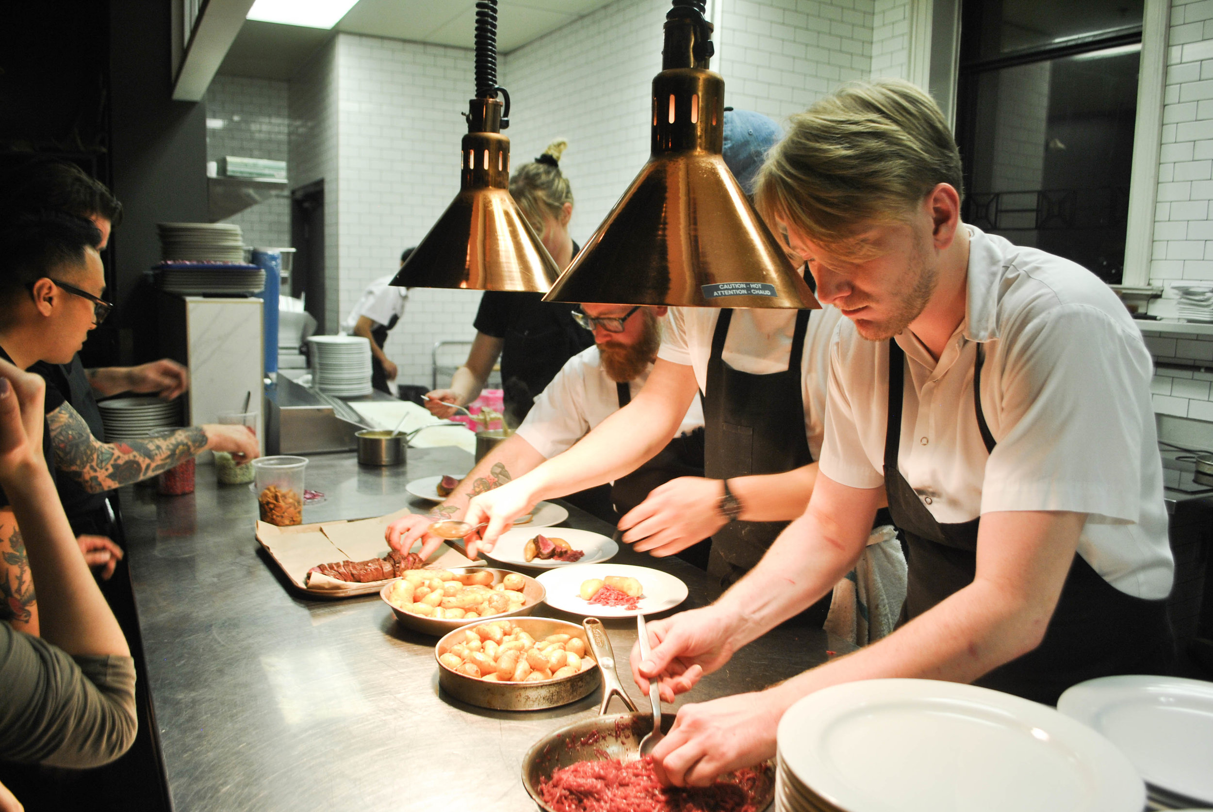 The Ayden crew plating The Hollows' 4th course dish