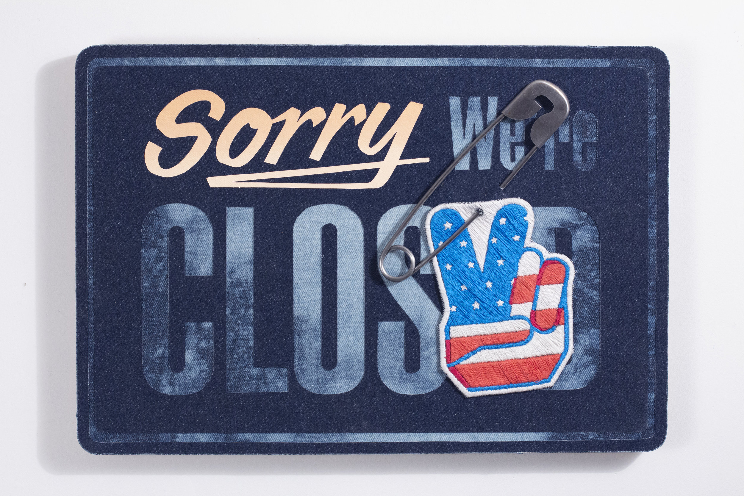 """Sorry we're closed"" 16.5x24x2 inches Steel, embroidery, flashe and denim on plywood 2019"