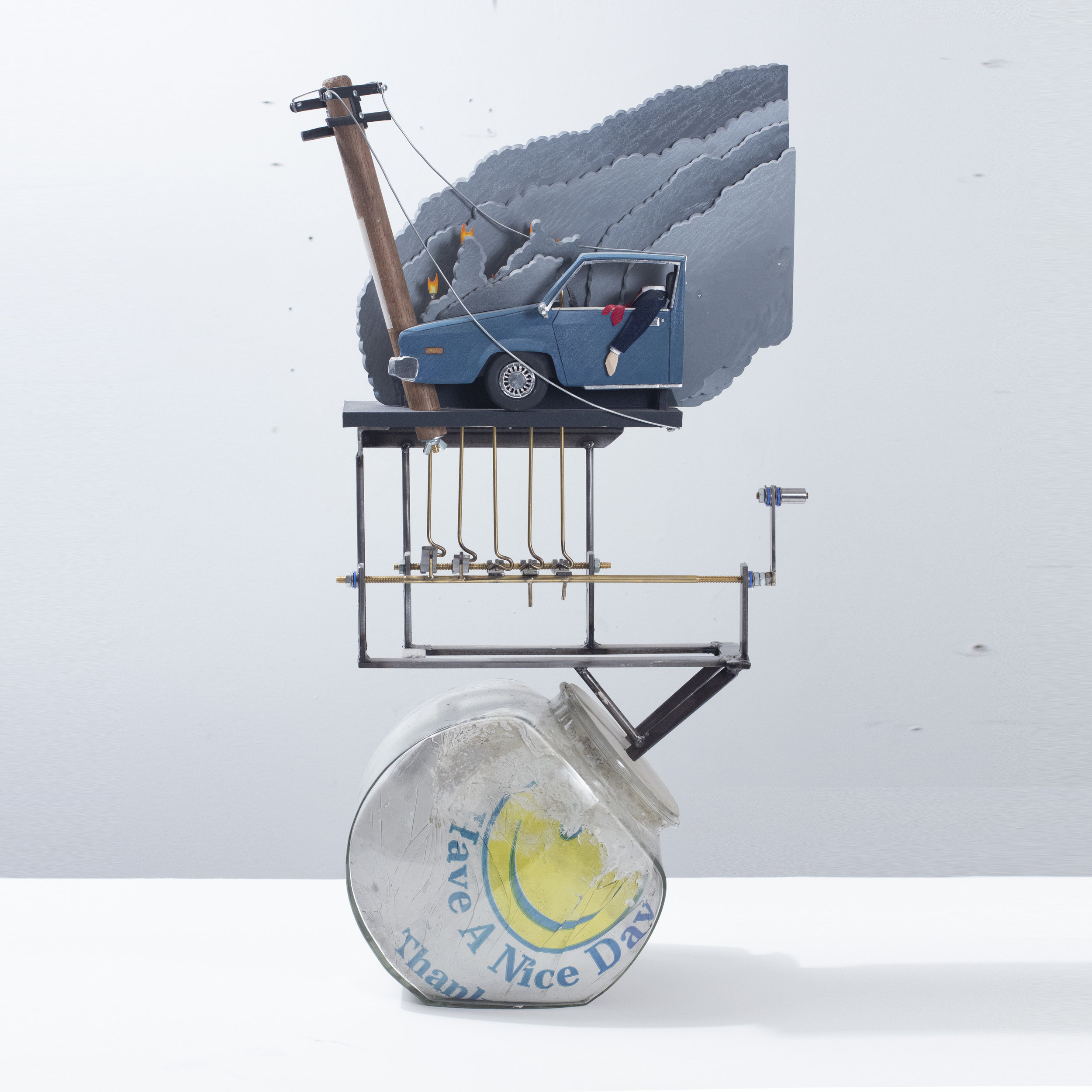 """""""Executive Toy: Crash and Burn"""" 2019 8x16x30inches Concrete, cookie jar, bodega bag, steel, plywood, denim, wire, brass, flashe, paper, cotton, sand paper, steel wire and hardware"""