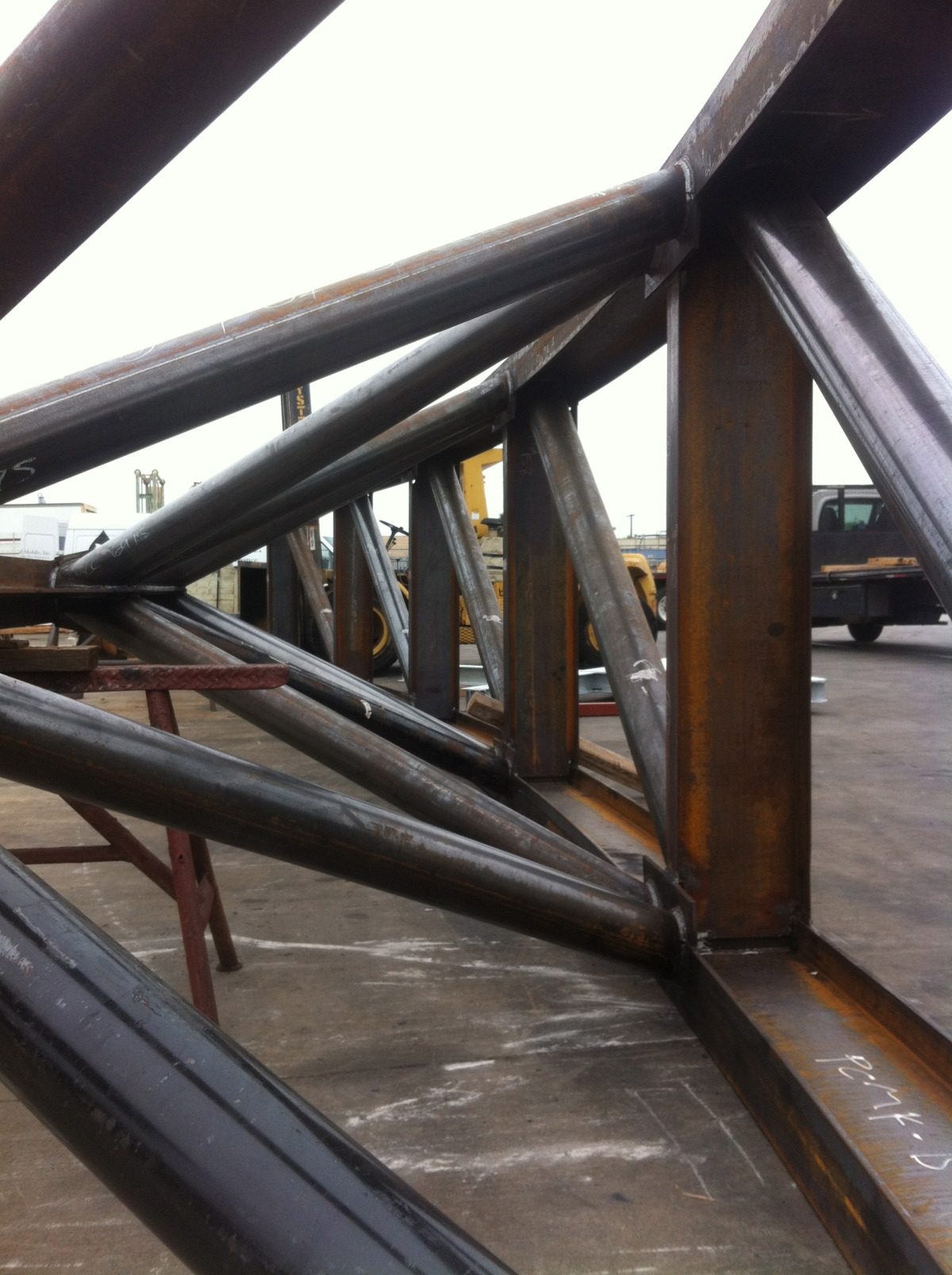 There are fourteen steel truss sections bolted and welded into place forming the 188 foot span of  Rainbow. The weight of the structural steel alone is over 100,000 pounds. The longest section is 40 feet and weighs over 30,000 pounds. Moving the sections required 10 flat bed trucks. Rainbow's  surface is made of648 aluminum panels covering over 7,760 square feet. The six colors required 163 gallons of paint. The fabrication and installation crew numbered 115 people. Like the movies made on the Sony lot, the creation of  Rainbow required a host of extremely skilled and varied artisans and construction workers.