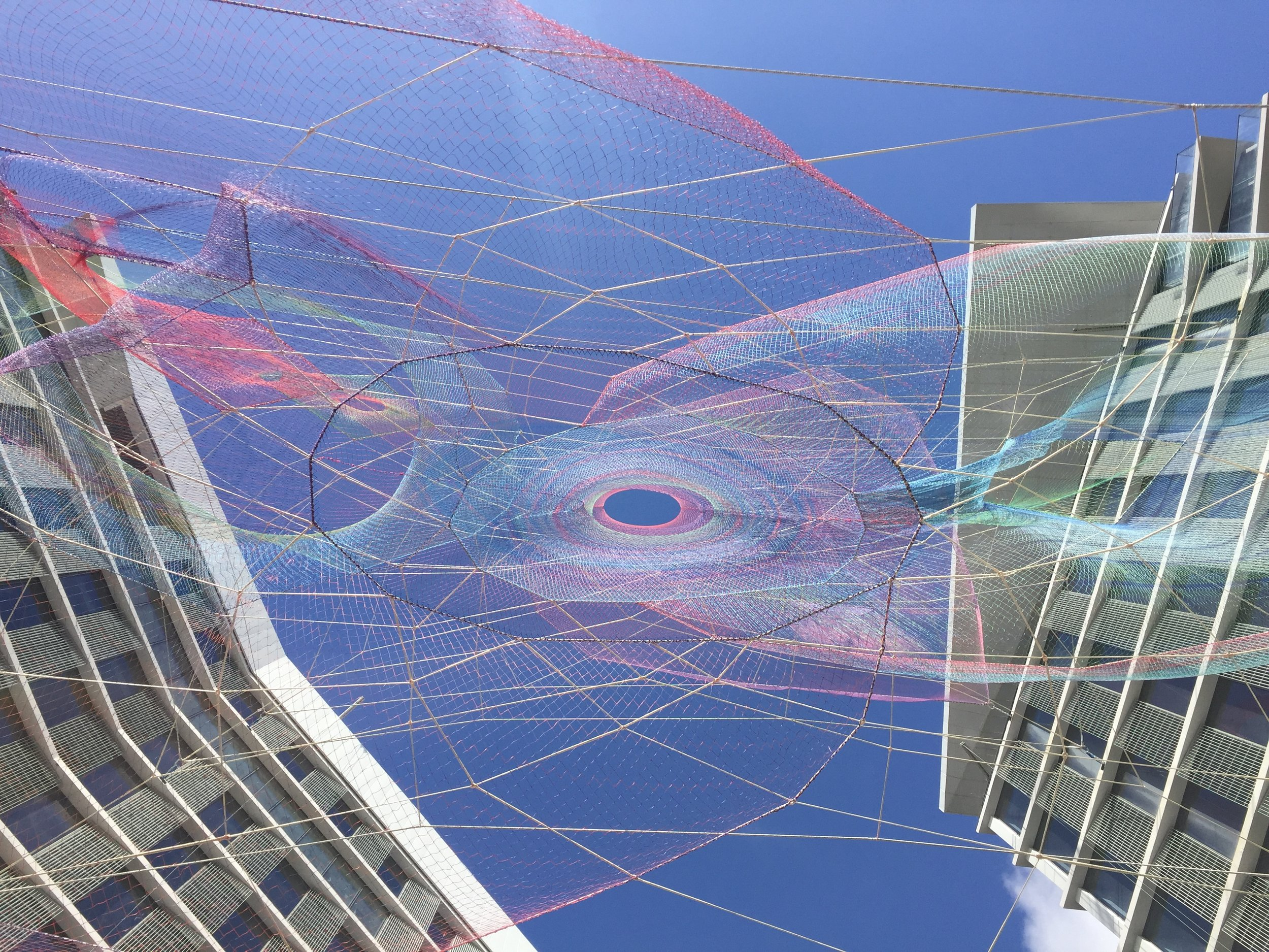 This daytime image is taken from the motor court entrance to the hotel approximately 120 feet below the top of the sculpture. From this perspective the sculpture is radically different than seen laterally at street level. Here viewers have a worm's eye view up and through the complex structure and can understand how the composition spins out from several organizing cores. An opposing perspective looking down is possible to enjoy from the 10th floor lounge.  Photo courtesy of: Nicole Wang/SOM Engineering, Courtesy Echelman Studio
