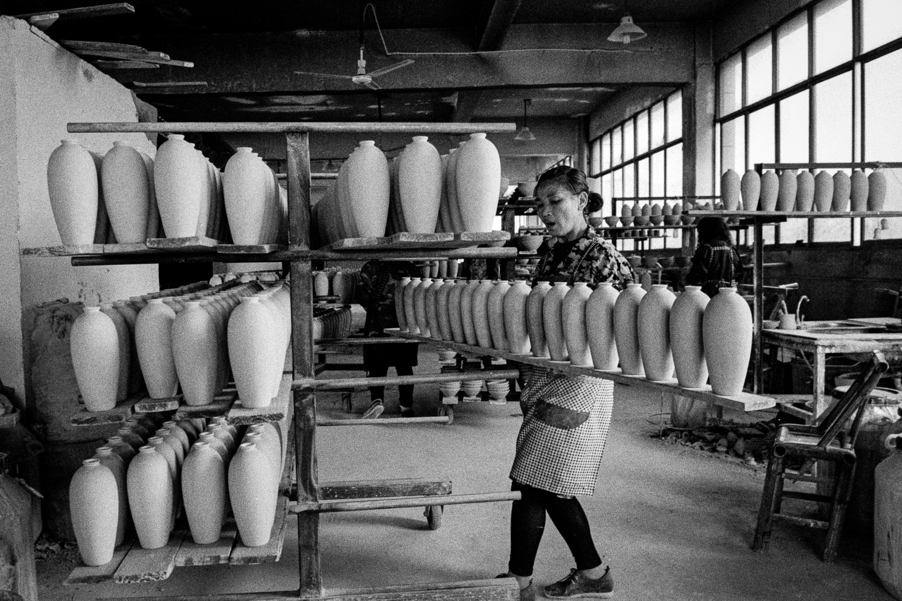 The porcelain makers using traditional hand process make fine china. Photo is shot on Ilford hp5 film, 2018.