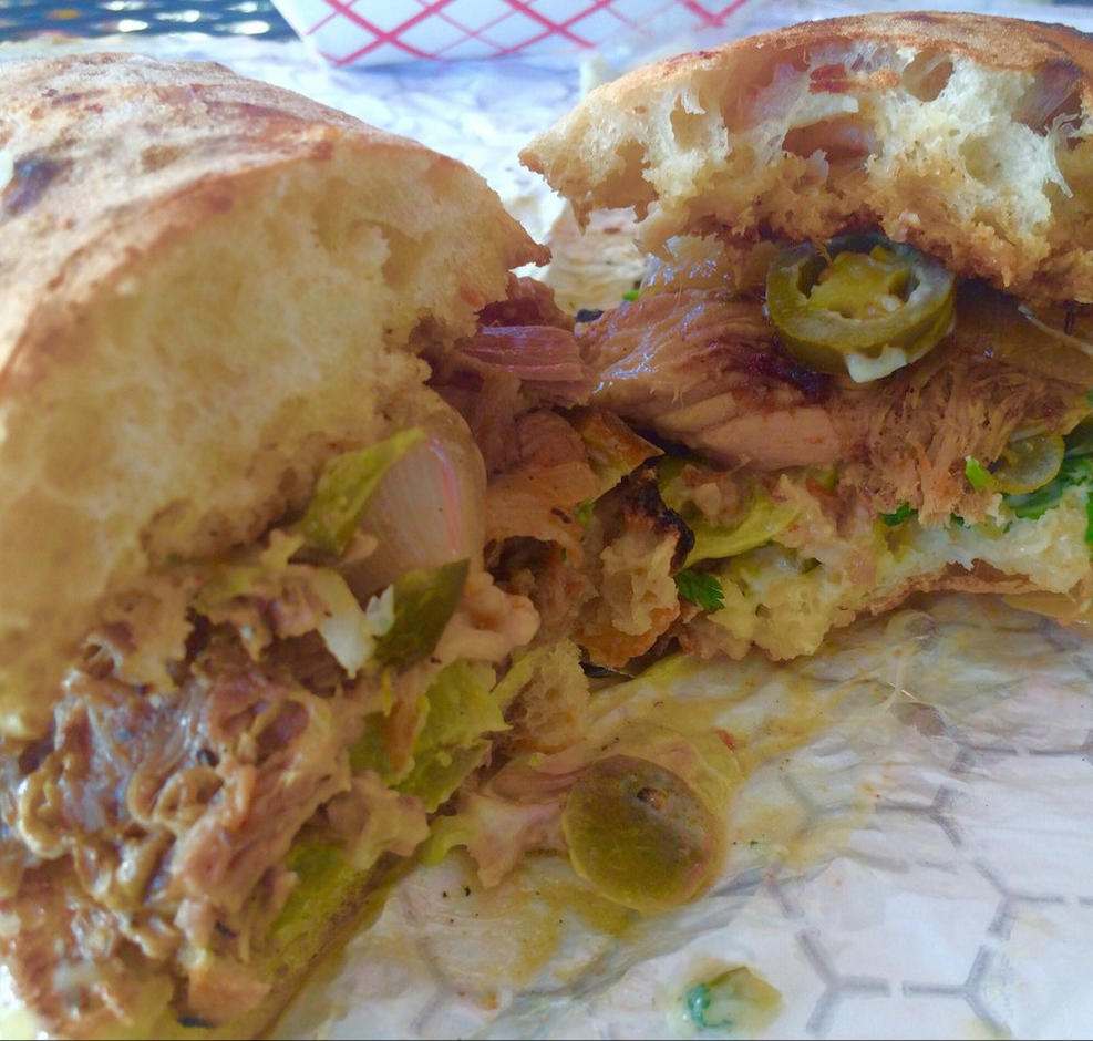 """Plump Sammy stuffed with pork, onions, and jalapeños. Damn good!"""