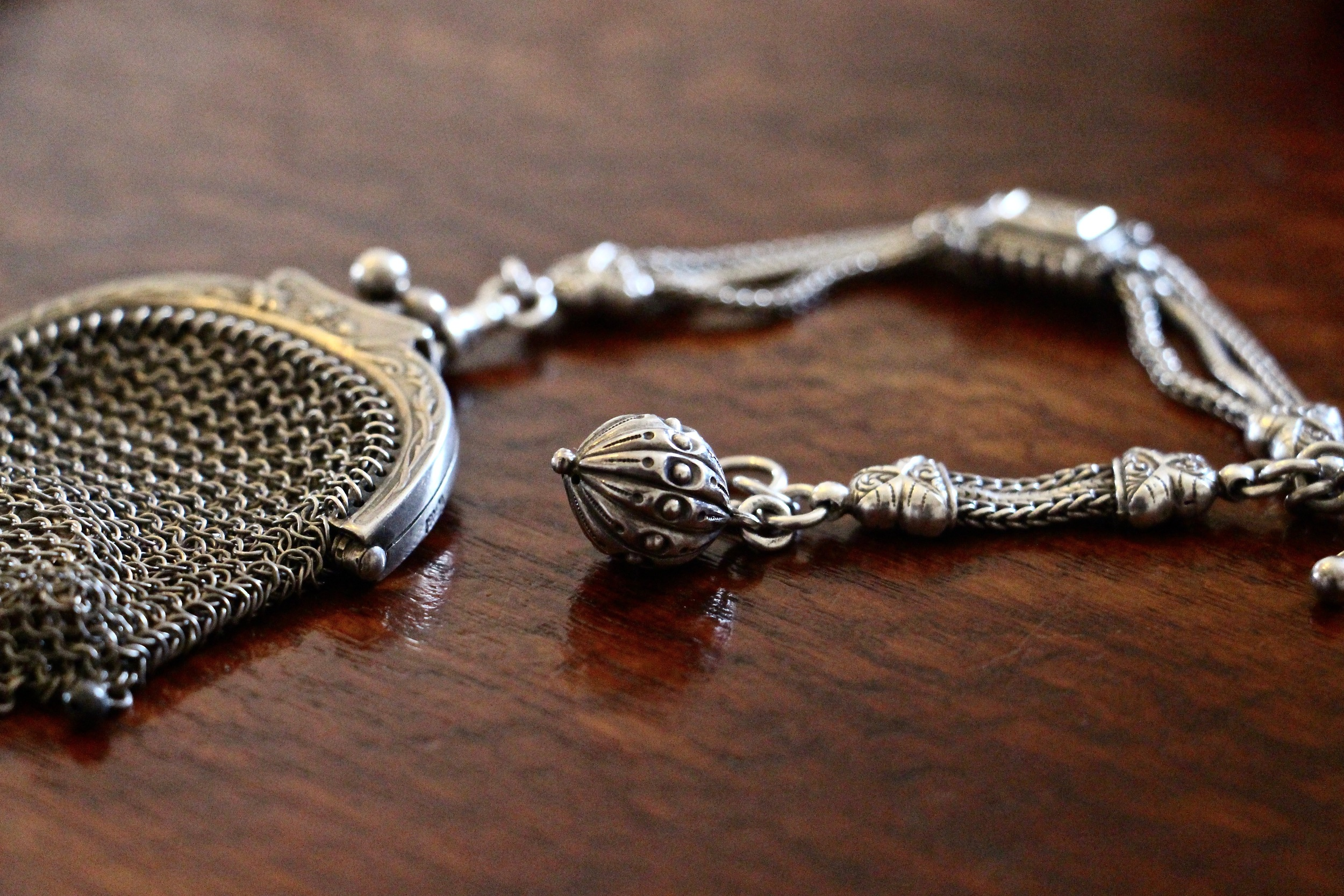 Silver chainmail coin purse with a sterling silver albertina. Est late 1800's.