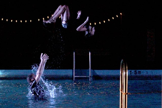 In The Deep End - A spectacular site specific circus/physical theatre show, in, around and above a pool with an ensemble of 24 young people. A collaboration between ASKING for TROUBLE and RUSSELL:EVANS