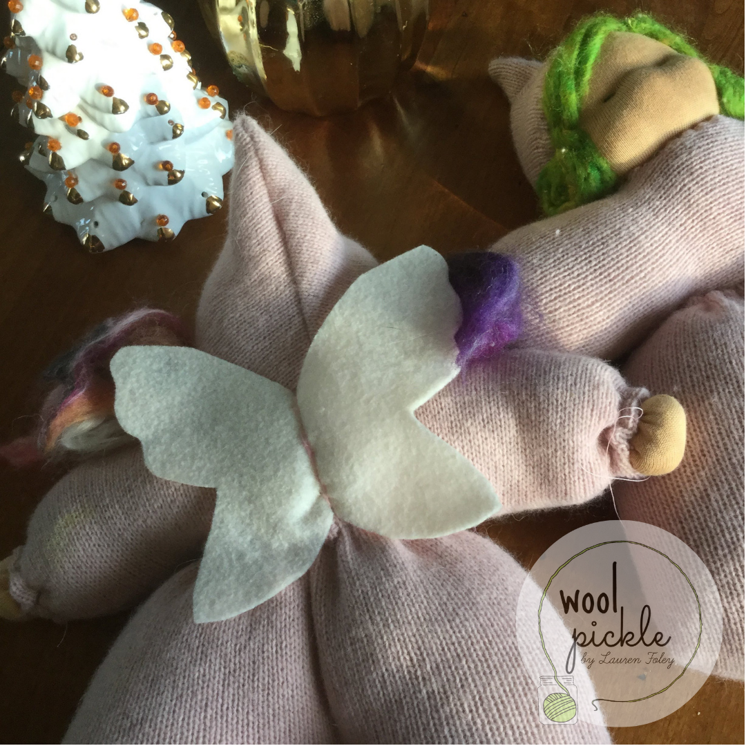 Wool felt wings and recycled cashmere from a sweater make these dolls special.