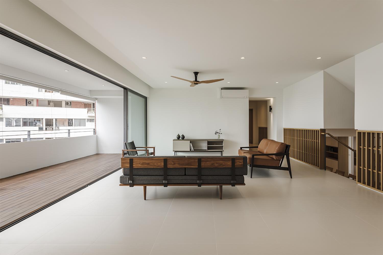Living room continues to large balcony at Pandan Valley Condominium