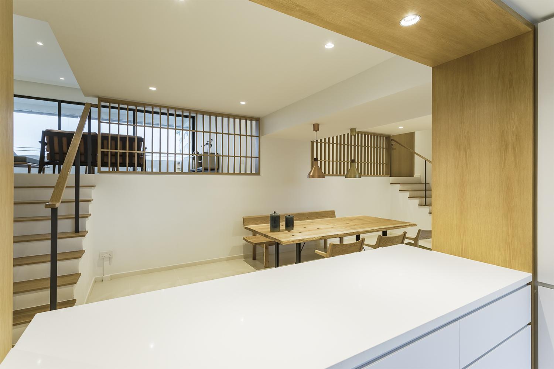 Kitchen counter provides visual continuity to dining room at Pandan Valley Condominium