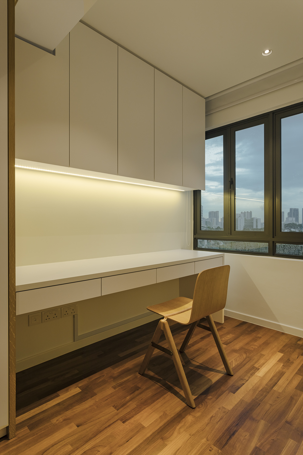 Study space in master bedroom Kitchen counter provides visual continuity to dining room at Pandan Valley Condominium