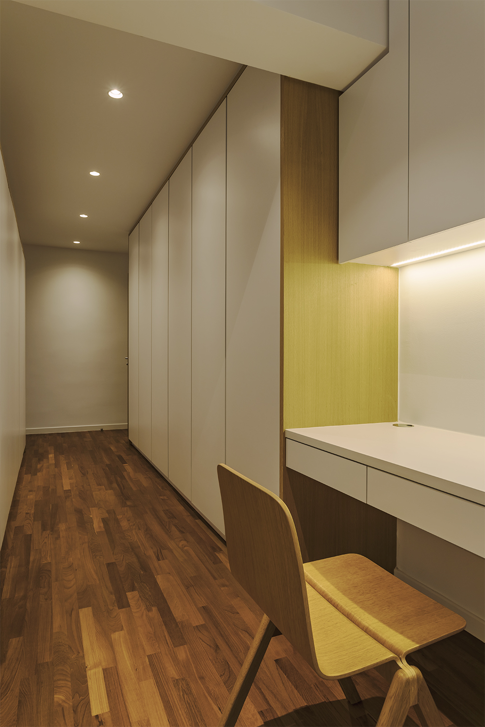 Master study space  and walk in wardrobe Kitchen counter provides visual continuity to dining room at Pandan Valley Condominium