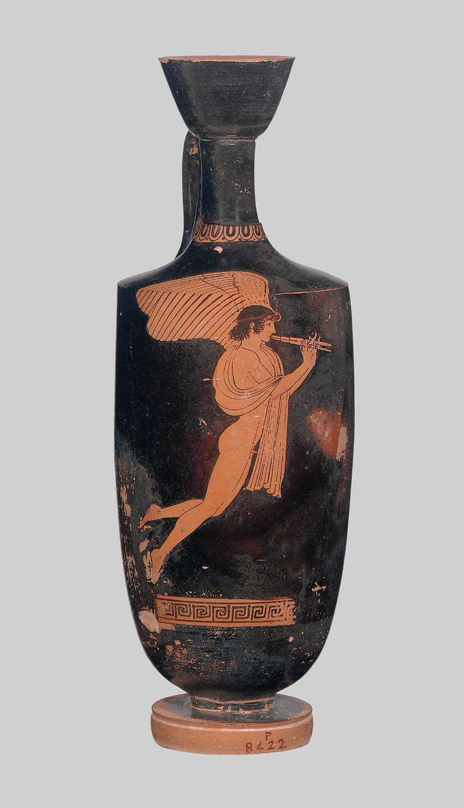 Oil Flask showing Eros as he plays the  aulos