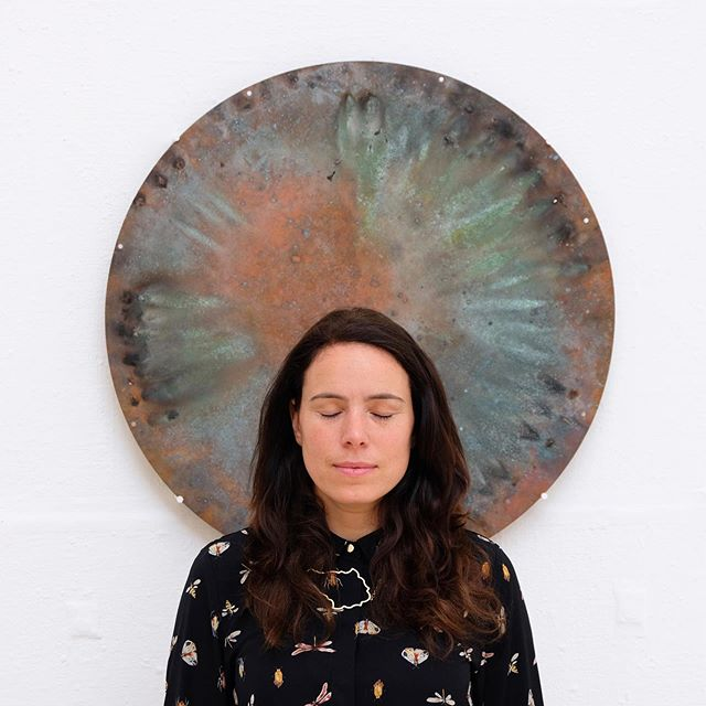 Portrait of Aoife with her art piece Sun III, exhibited at RWA in Bristol, as part of Fire: Flashes to Ashes in British Art 1692-2019. Open until 1 September. 'Sun III is a relic left behind after one of Linden Tol's contemplative performances in which flames converged to create a jet of fire that leapt out at the audience. A trained Pyrotechnician, Linden Tol's work uses fire and explosives with which to her interest in nature, cosmological phenomenon, chemistry and physics. This has led her to explore how concepts of time, density and matter are bound to deep human emotions and motivations. Fusing art and science she has undertaken artist residencies at the European Space Agency and Ars Electronica Futurelab.' #portrait #art #explosives #performance #relic #copper #artist #show #exhibition #rwa #bristol #sun #science #scienceart #cosmos #fire #firestarters #explosiveart #explosiveartist #immersiveart #contemporaryart #aoifevanlindentol #wildandserene #serene #chemistry #meditation