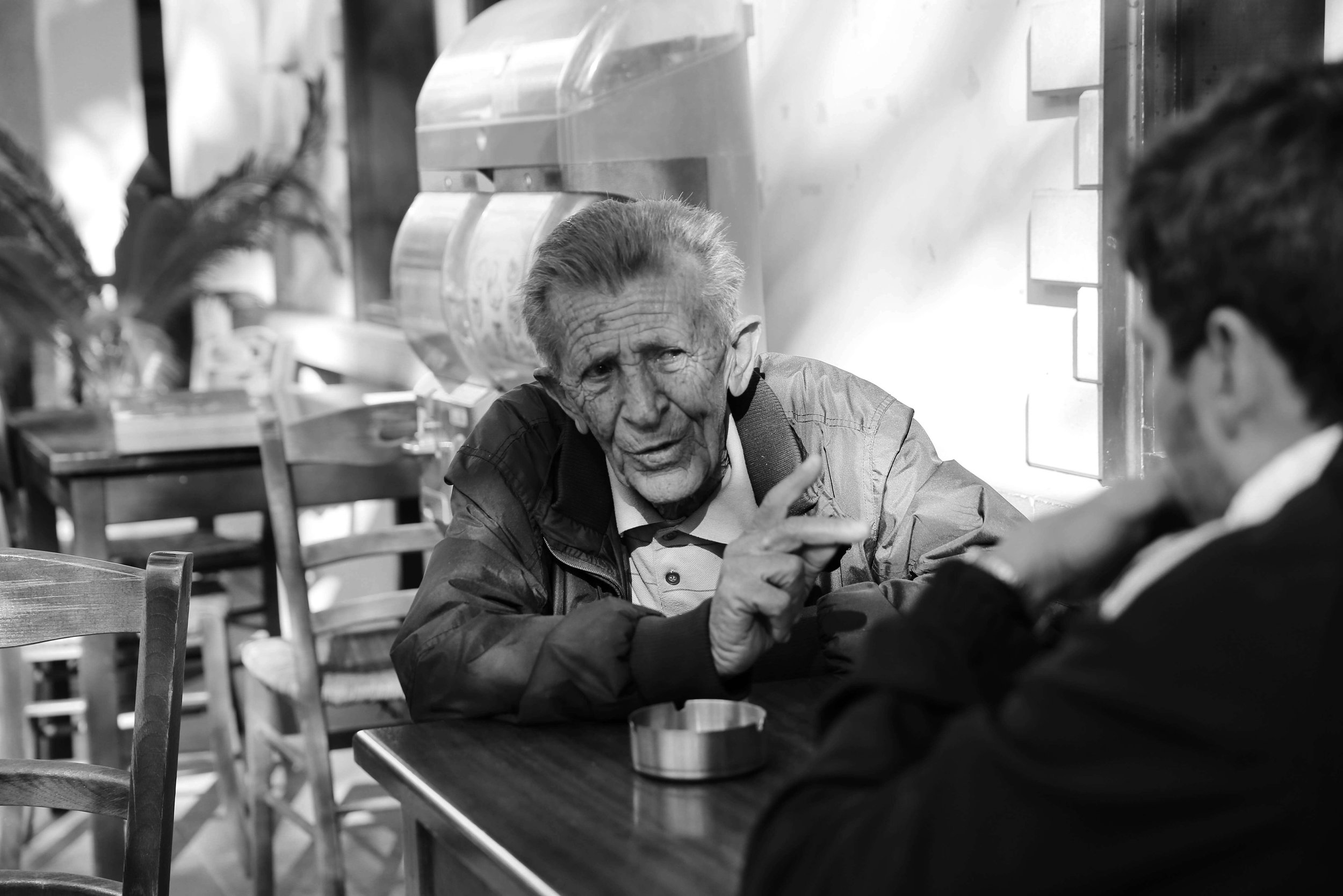 Not missing a single opportunity to meet someone new, hear their story and share a moment.  An old man sitting alone drinking his coffee at a coffee shop in Kato Pyrgos, welcomed the young man who sat down to chat with him during a short bathroom stop.