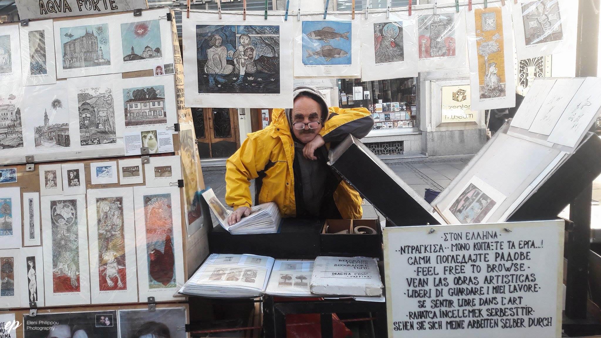 street artist selling his work in Belgrade, Serbia