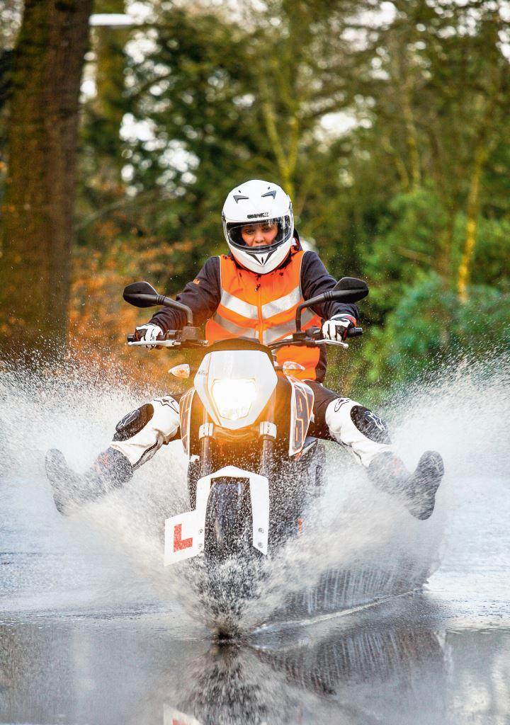 Aimee Fuller rides through water