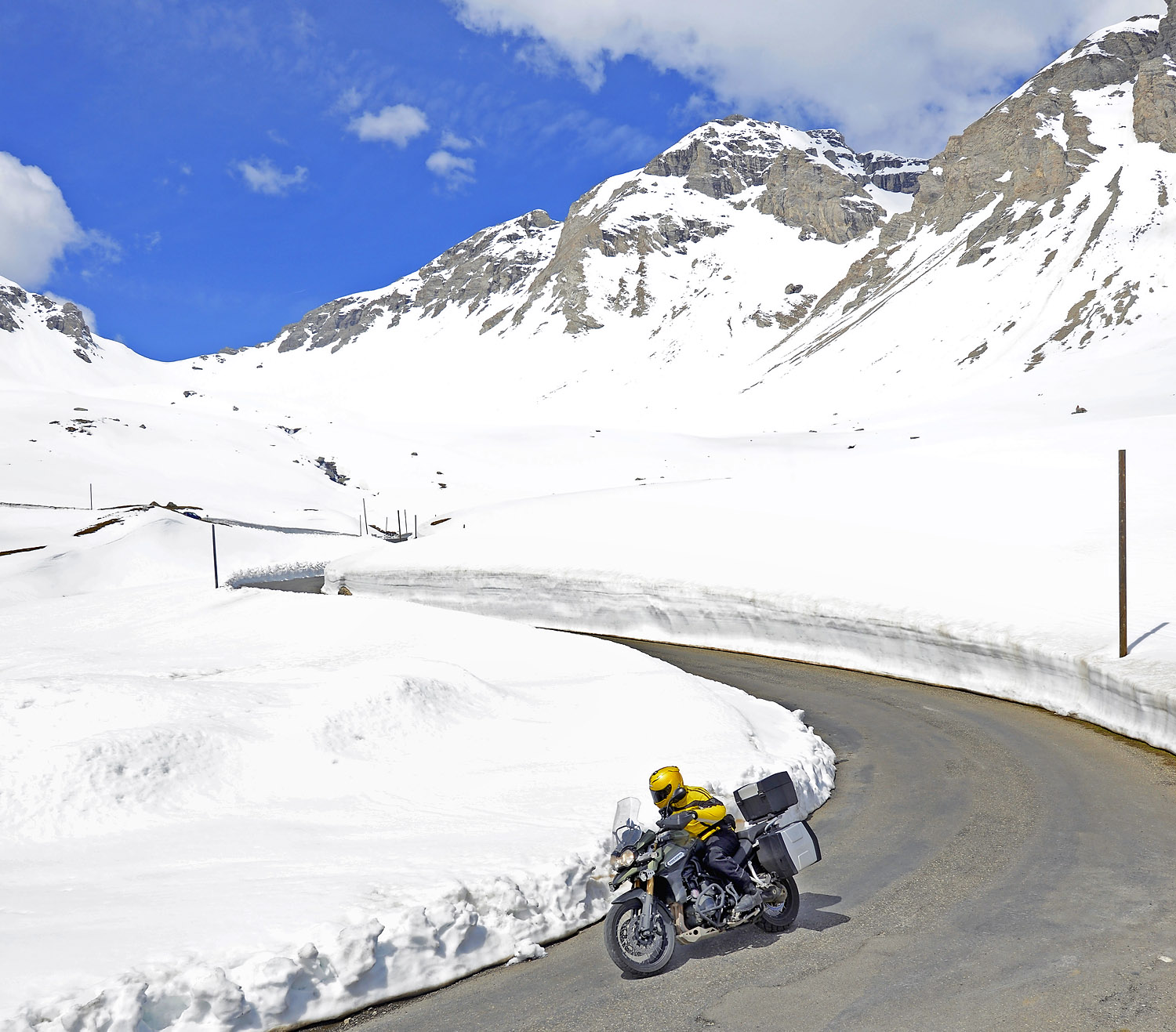 The D902 Col de la Cayolle presents an amazing spectacle, weaving between snow walls