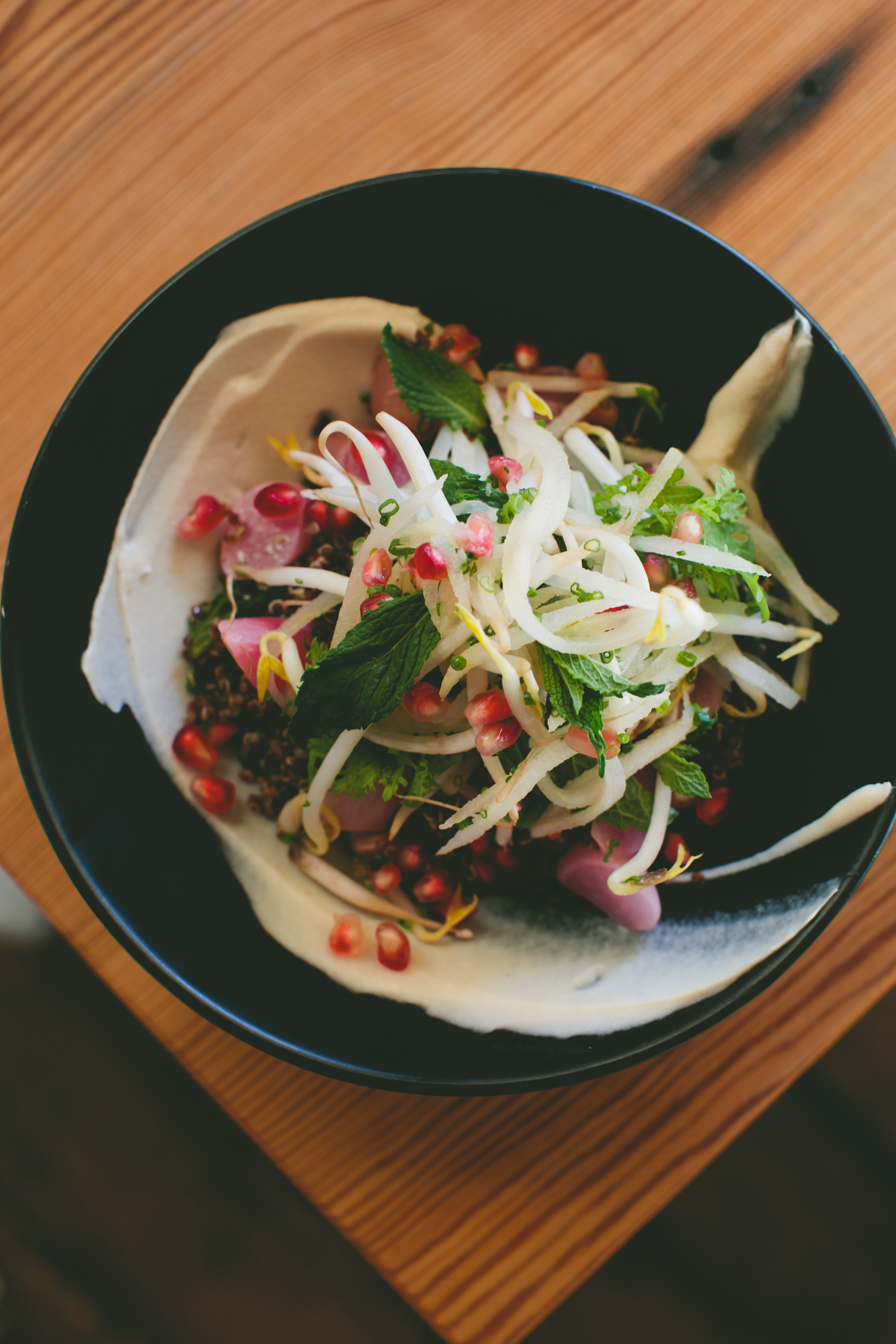 Quinoa, coconut, radish, pomegranate, and kimchi at West Bridge|| via A Thought For Food