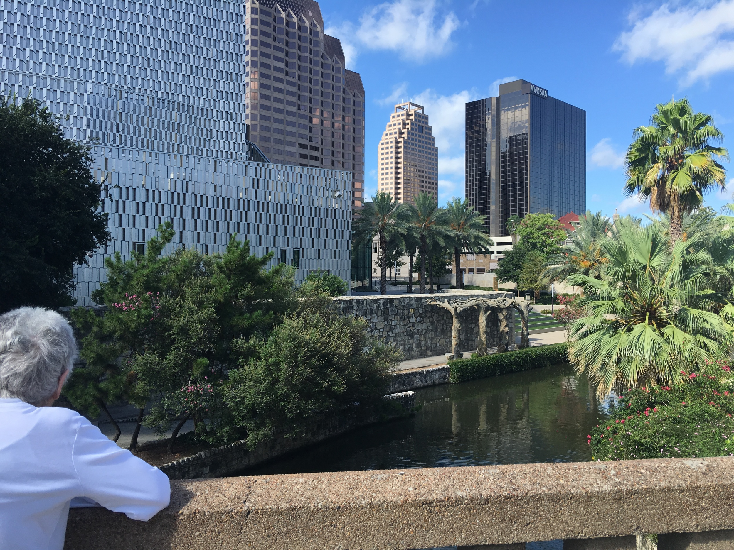Marcia on the Riverwalk overlooking the Tobin Center for the Performing Arts & SA skyline
