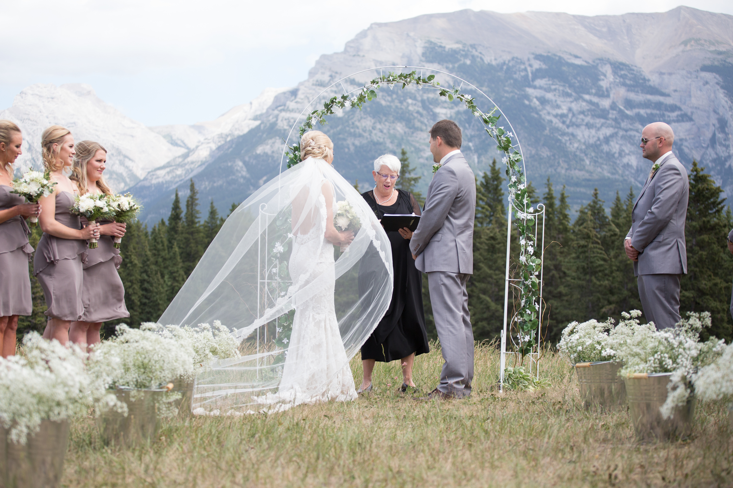 Beautiful outdoor wedding ceremony among the Rocky Mountains in Quarry Park, Canmore, Alberta