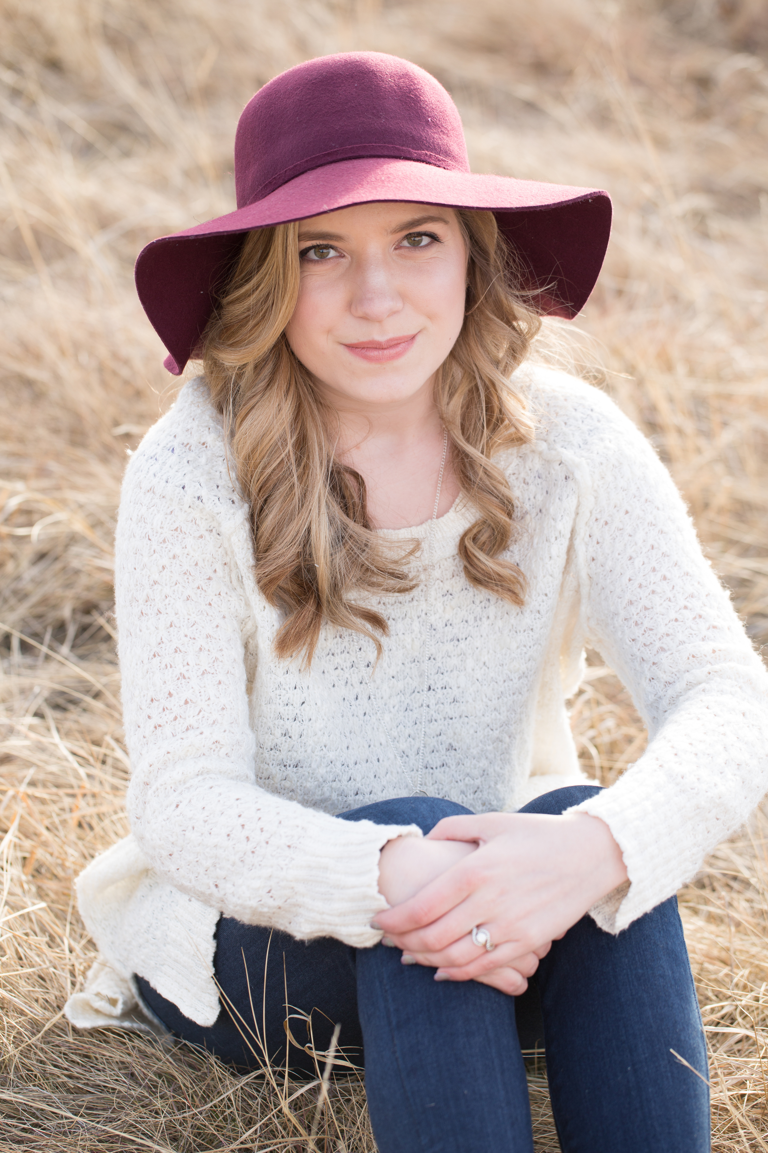 engagement outfit inspiration with cream sweater and red hat
