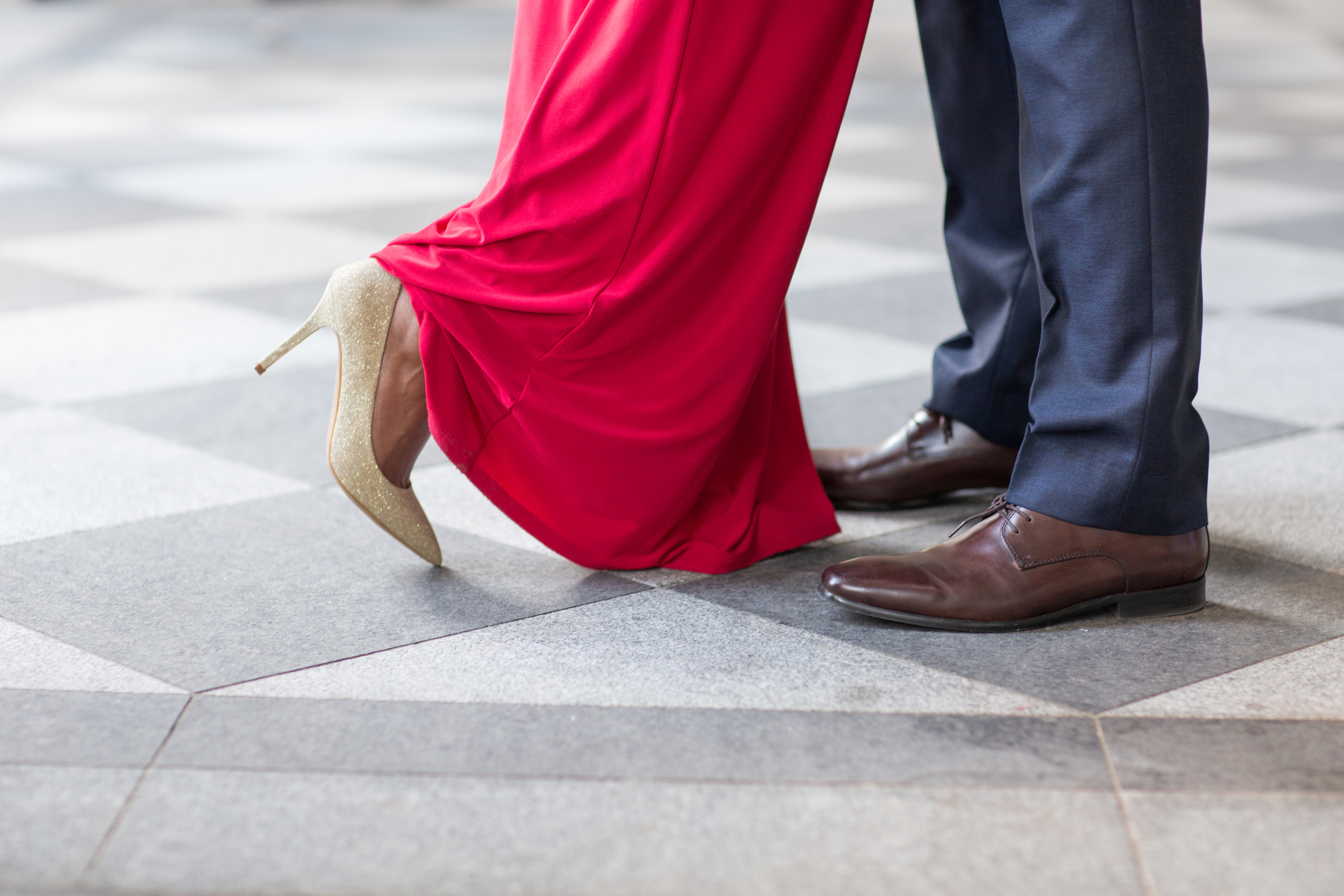 Elegant european style engagement photograph with red dress