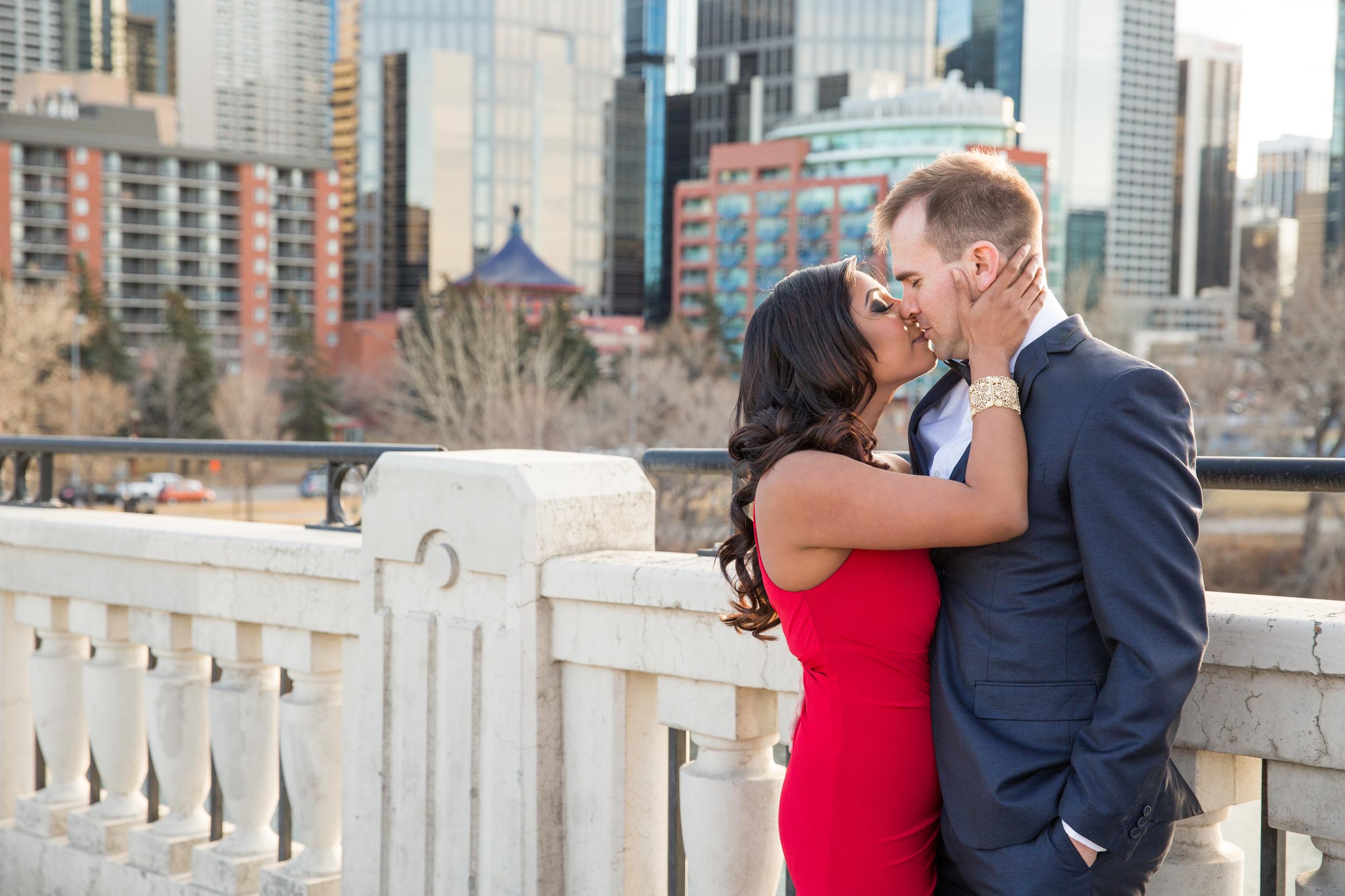 Centre Street Bridge engaged couple kissing