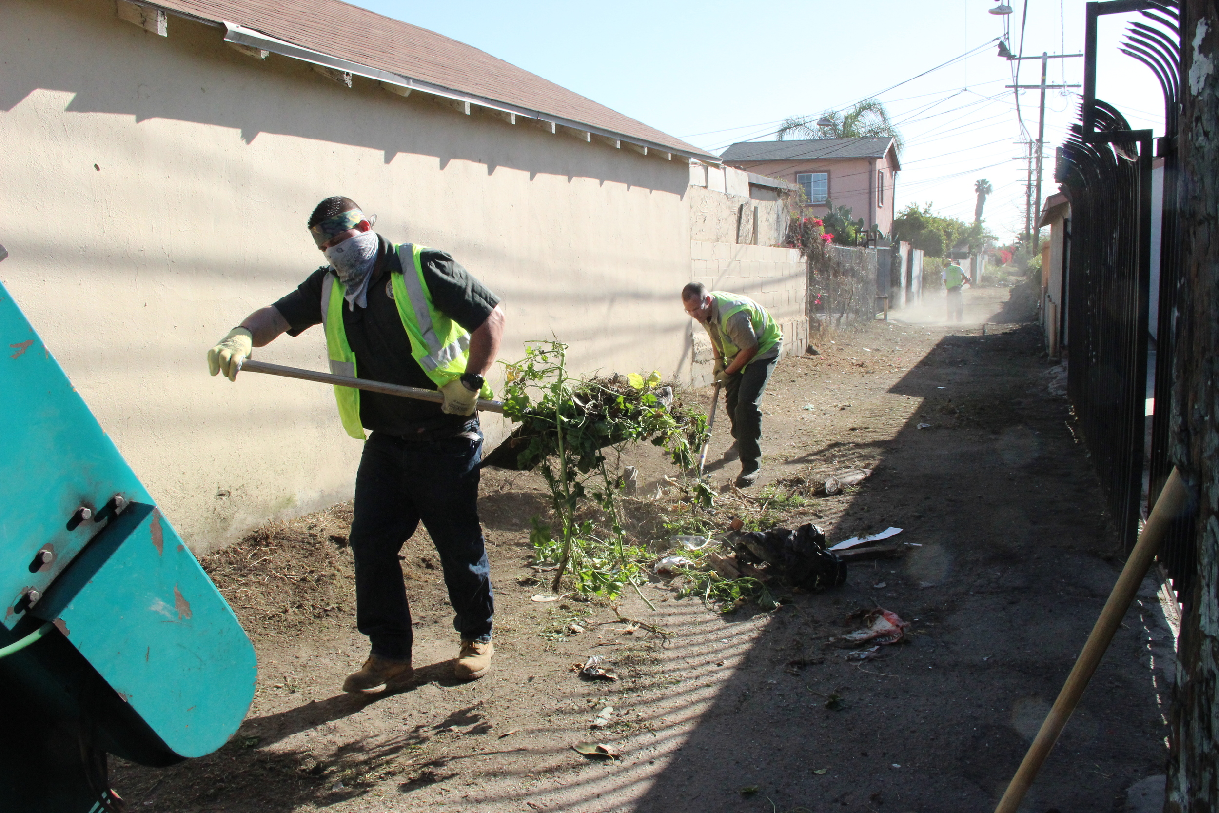 Clean Streets L.A. crews use a two ton rear loader collection truck with hand and power tools to remove abandoned waste and overgrown vegetation in a dirt alley more than 350 yards long.