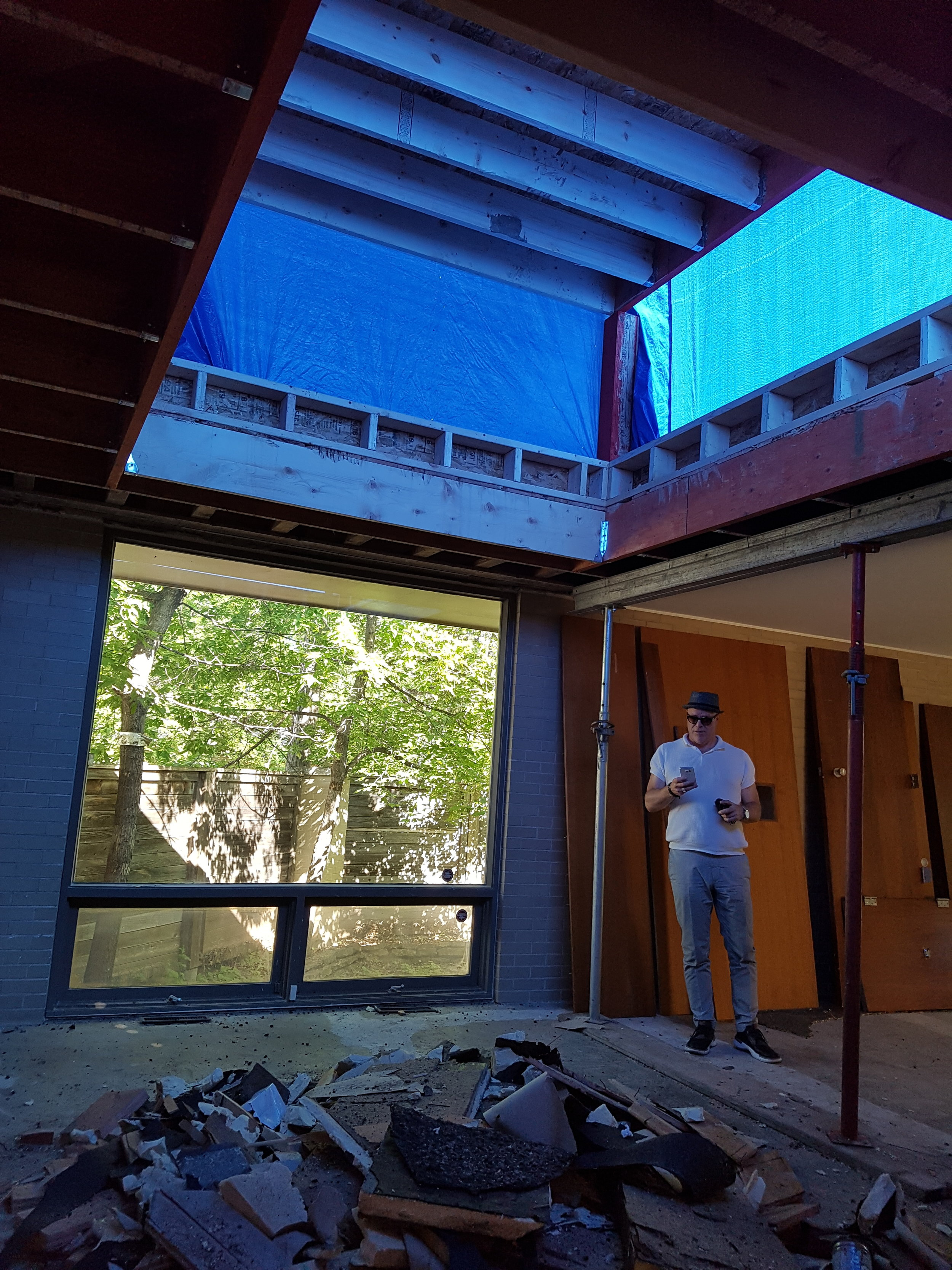 Progress shot in raising the dining room ceiling and adding clerestory windows.