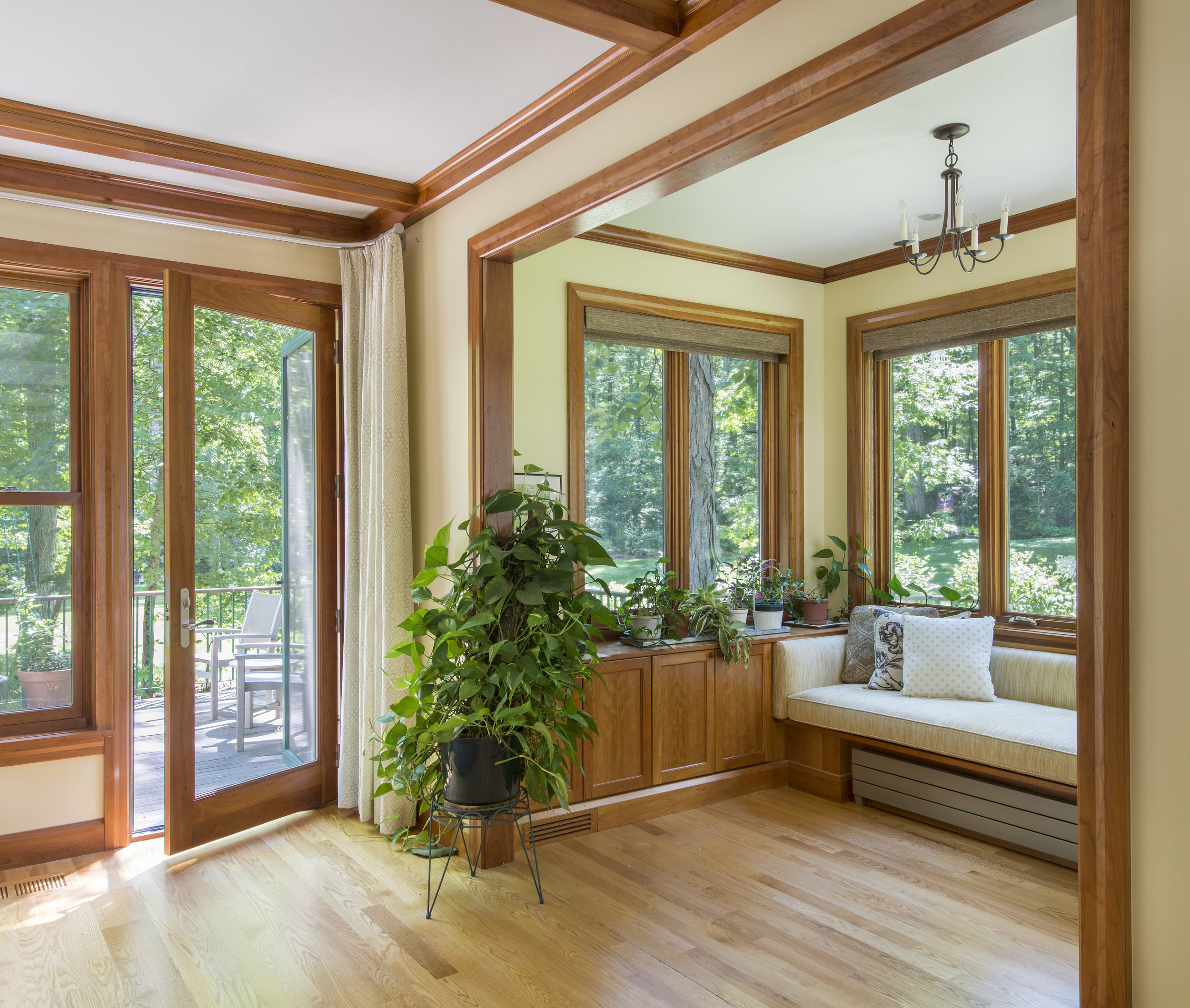 Wood windows with custom built-in seat