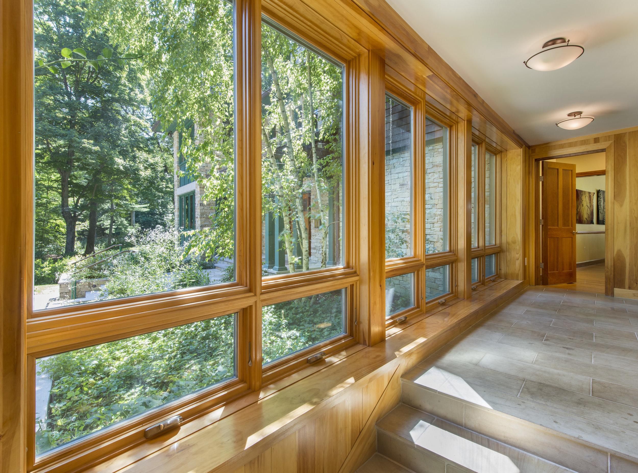 Sunny mudroom with wood windows
