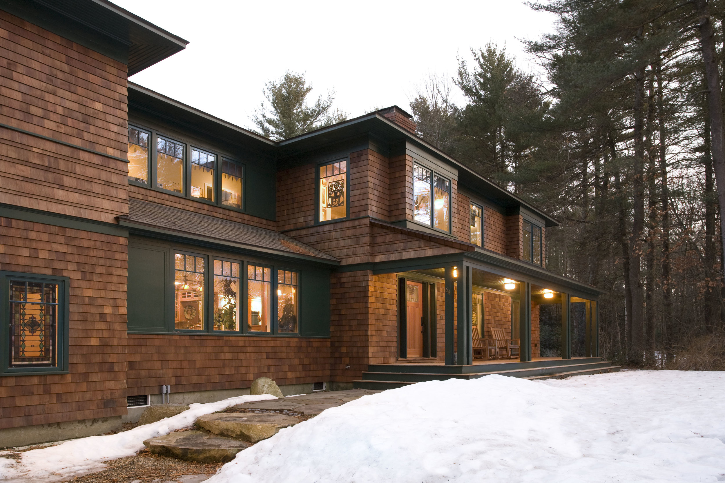New shingled home in the woods