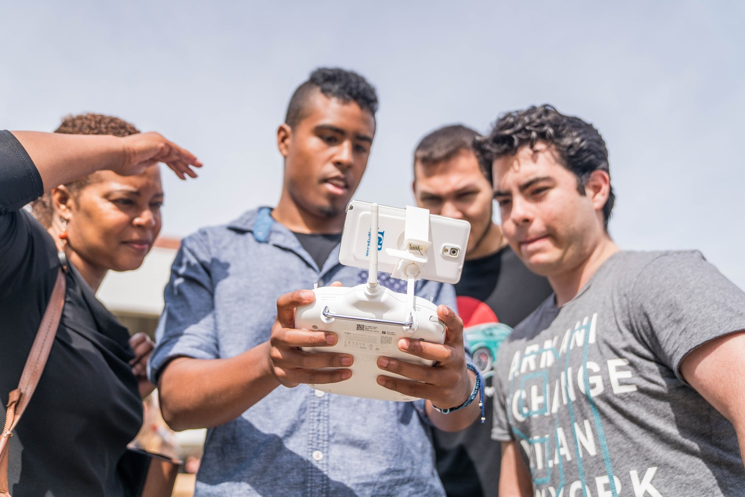 Cameron Cabading (center) introduces others to modern drone technologies at an event with the St. Mary's College Engineering Club