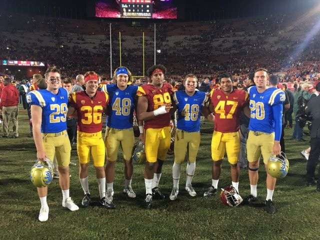 From left, safety RYAN PARKS '17, wide receiver JACK WEBSTER '17, tight end CONNOR BEADLES '17, linebacker CHRISTIAN RECTOR '15, linebacker WINSTON ANAWALT '17, fullback REUBEN PETERS '14, punter STEFAN FLINTOFT '14. Not pictured was USC right guard CHRIS BROWN '14, who had been injured during the game. The photo illustrates the mantra, 'Cubs for life'.
