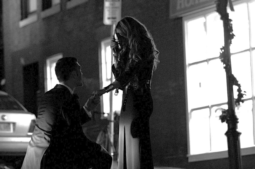 BG proposing in front of our first apartment together. Phillips St. Beacon Hill. Right in front of a kitchy laundromat that looked like it belonged on a movie set.