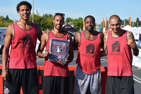 From left to right: JB Pillard III, Evan Jordan, Drew Reddy and David Seversen of The Foster Group Realty team pose with the trophy after winning the title in the men's competitive division at the Hoop It Up 3-on-3 tournament Saturday, July 4, at Zuanich Park.