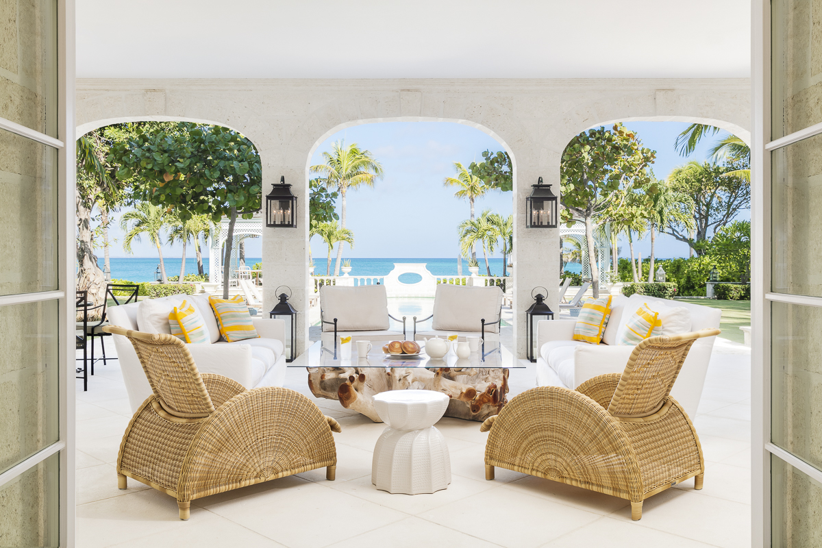 Interior Design Photography | Ocean-facing seating area at Coral Pavilion, Turks and Caicos. Design by Domino Creative.
