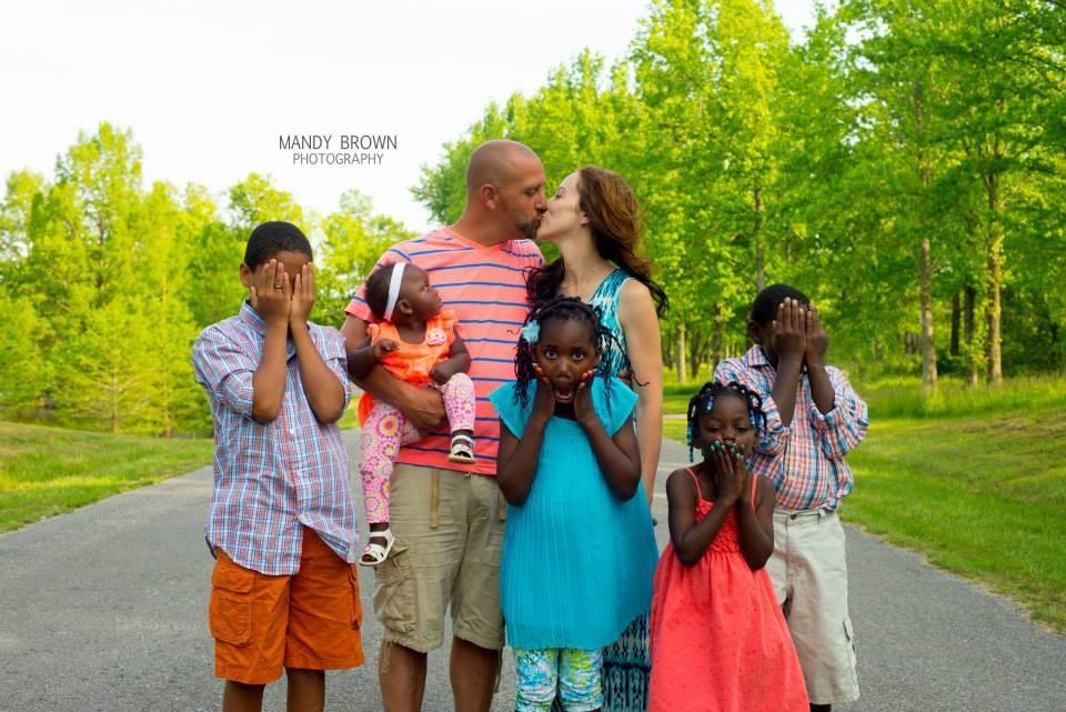 Keri M Sneaking a kiss Family.jpg