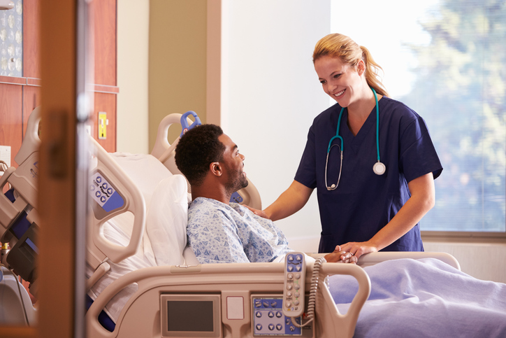 Female-Doctor-Talking-To-Male-Patient-In-Hospital-Bed-504477488_727x484.jpeg