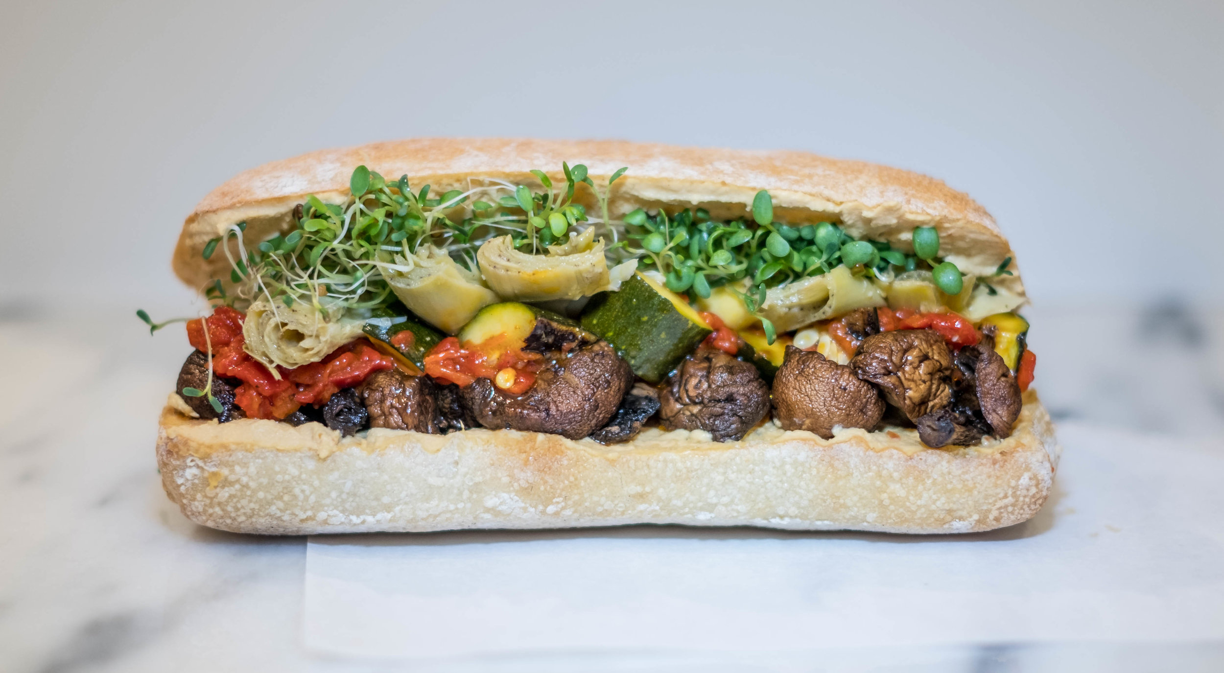 Veggies + Hummus - ROASTED MUSHROOMS, MISO CHARRED ZUCCHINI, PIQUILLO PEPPERS, ARTICHOKES, LEMON-HARISSA HUMMUS, ALFALFA SPROUTS, CIABATTA (VEGAN)