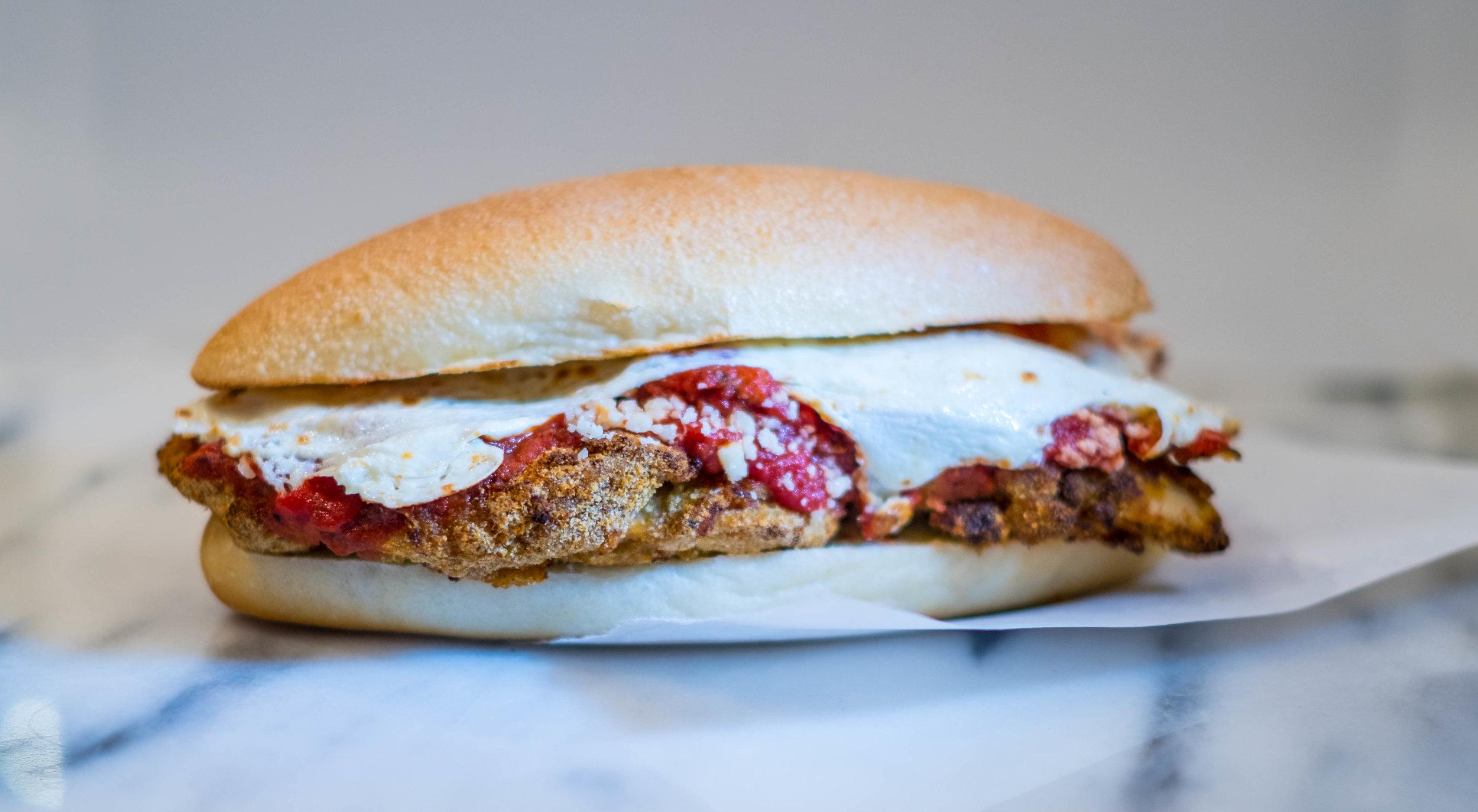 Chicken + Parm - PARMIGIANO-HERB CRUSTED CHICKEN, CALABRIAN TOMATO SAUCE, OAXACAN CHEESE, VALSERENA SOLO DI BRUNA PARMIGIANO REGGIANO, SUB ROLL - $10.95