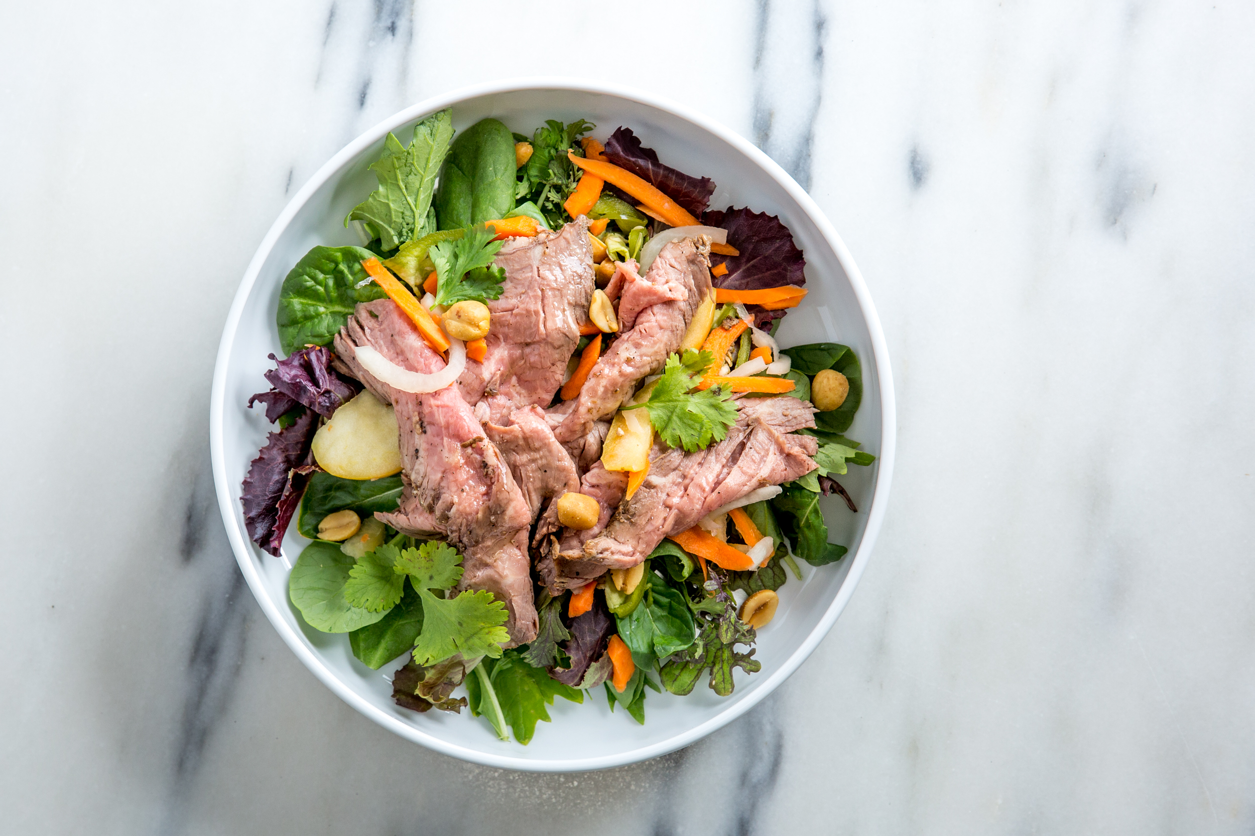 Hanoi Steak Salad - Roasted Tri-Tip + Asian pickles + cilantro + peanuts + Viet Vinaigrette + Greens - $11.95